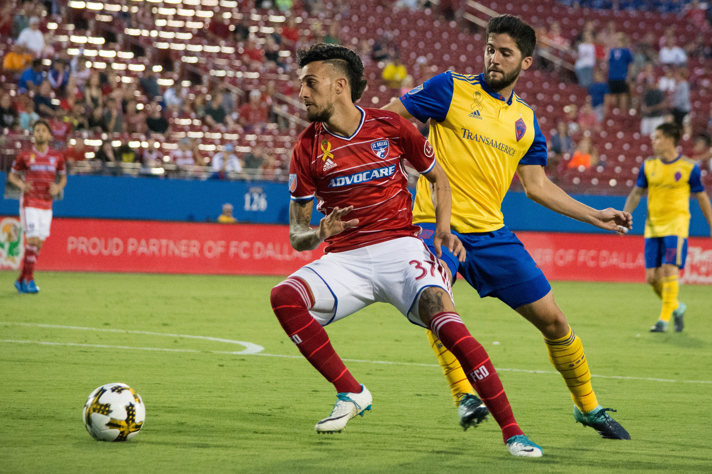 FC Dallas Maximiliano Urruti beats a Rapids defender Eric Miller.