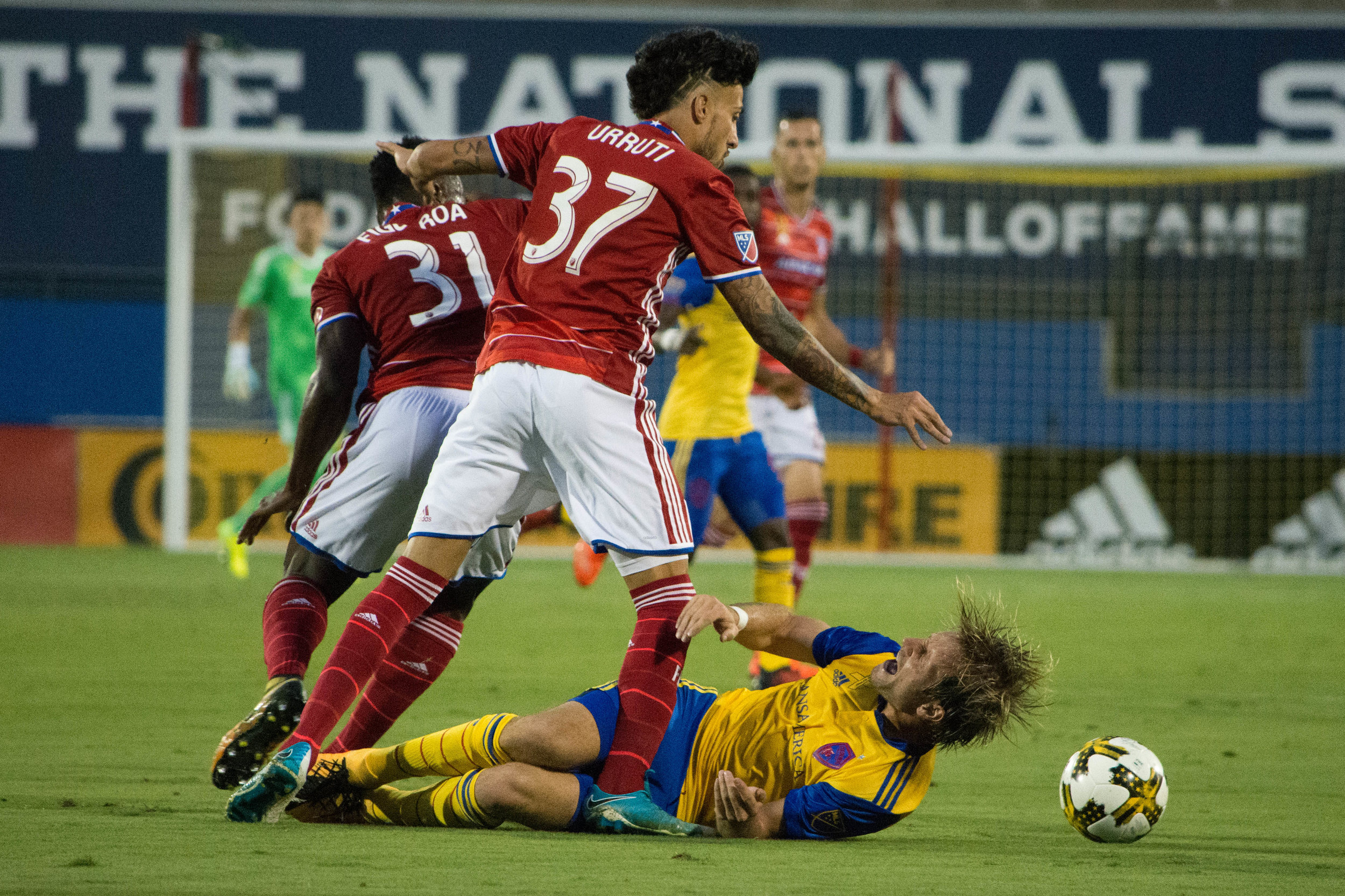 FC Dallas Maximiliano Urruti takes down a Rapids player