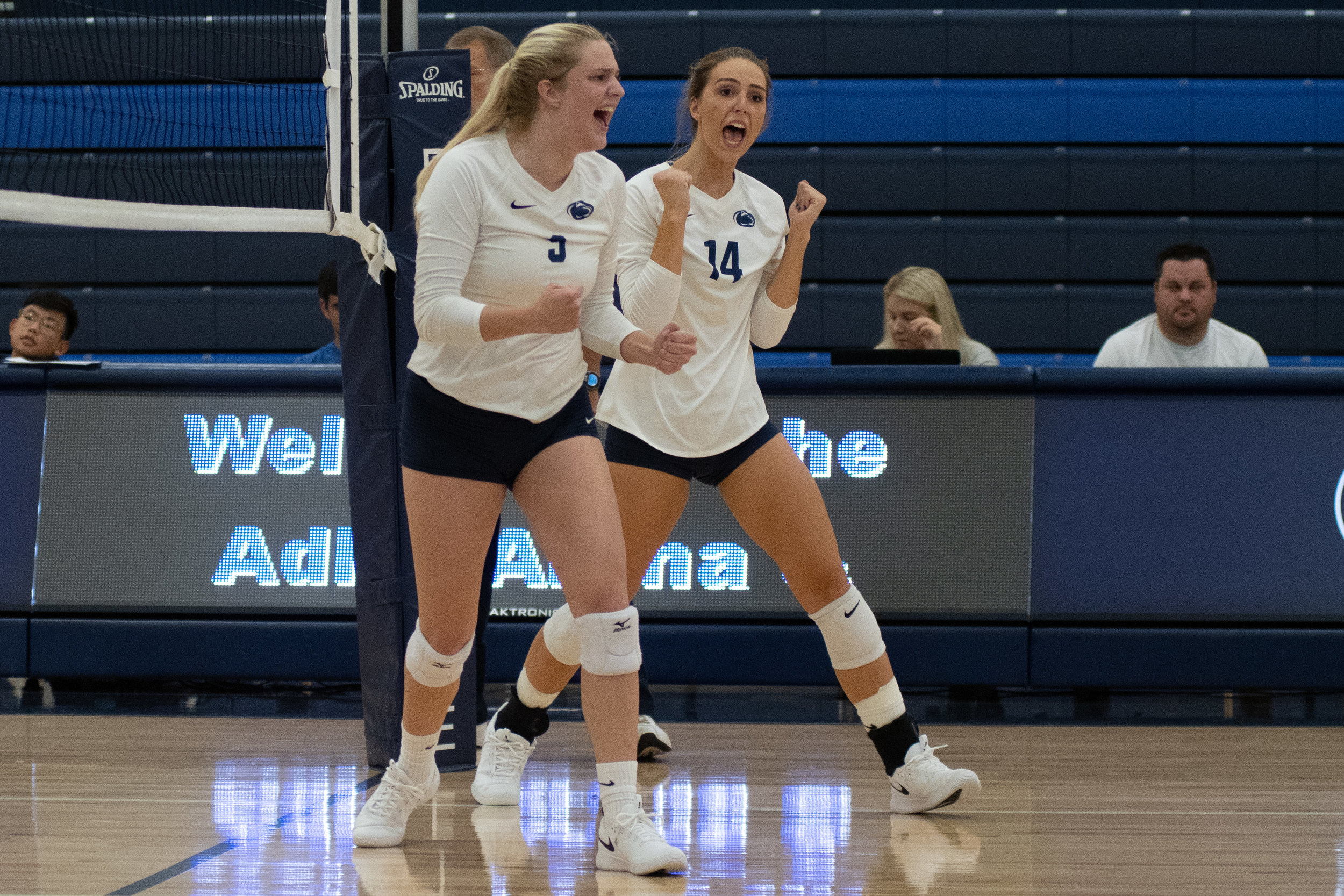 Penn State Altoona Women's Volleyball players Alexis Cannistraci (#9) and Eden Taddei (#14) celebrate scoring in their 3-0 loss to Penn State Harrisburg.