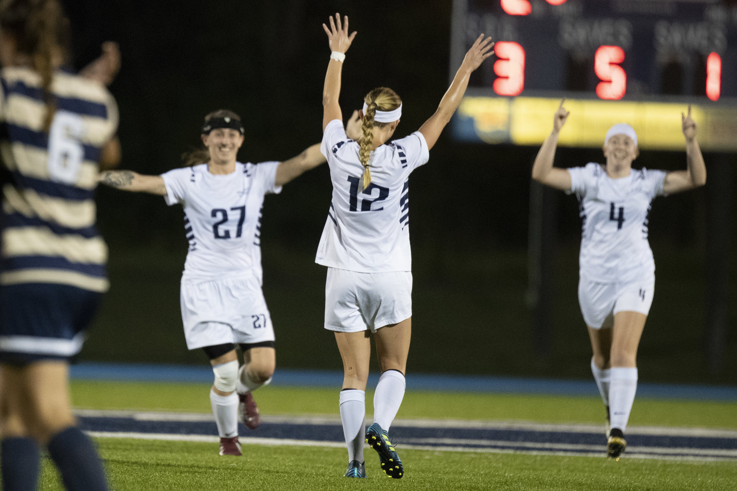 Penn State Altoona Women's Soccer player Haley Giedroc (#12) celebrates scoring with teammates Kierra Irwin (#27) and Mara Brackett (#4) in Altoona's 4-1 win against Juniata College on Wednesday, September 19th, 2018 at Spring Run Stadium. - Photo By: Noah Riffe