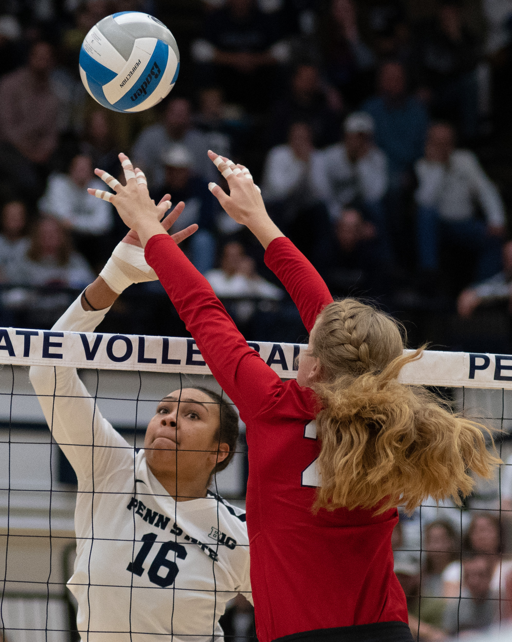 Middle blocker Serena Gray (16) spikes the ball during the game against Nebraska at Rec Hall on Saturday, October 13, 2018. The Nittany Lions defeat Nebraska in 3-2 sets. | Photo by: Noah Riffe