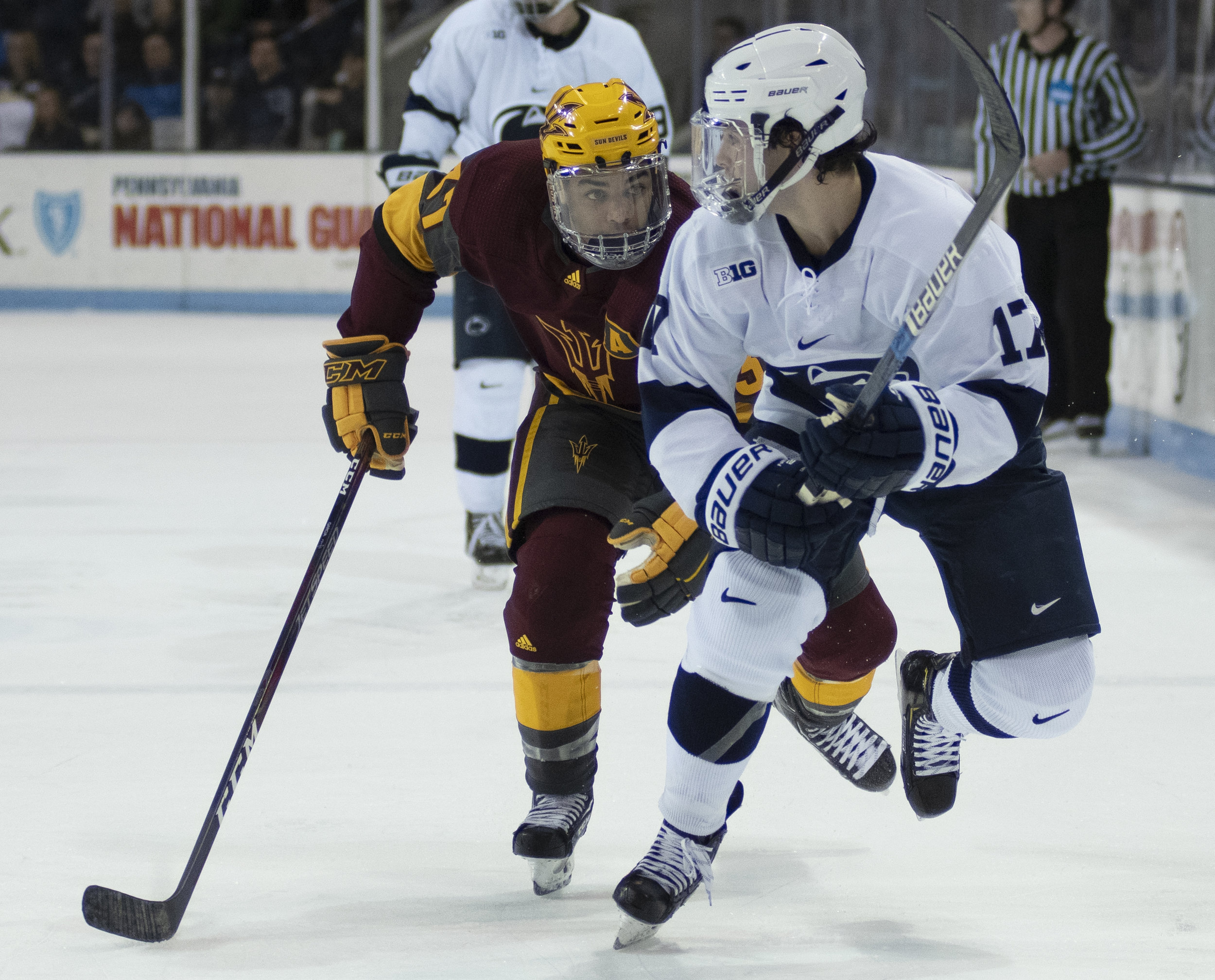 Forward Evan Barrett (17) battles for a puck during game against Arizona State at Pegula Ice Arena on Saturday, Nov. 3, 2018. The Nittany Lions fall to Arizona State 4-3 in overtime. | Photo by: Noah Riffe