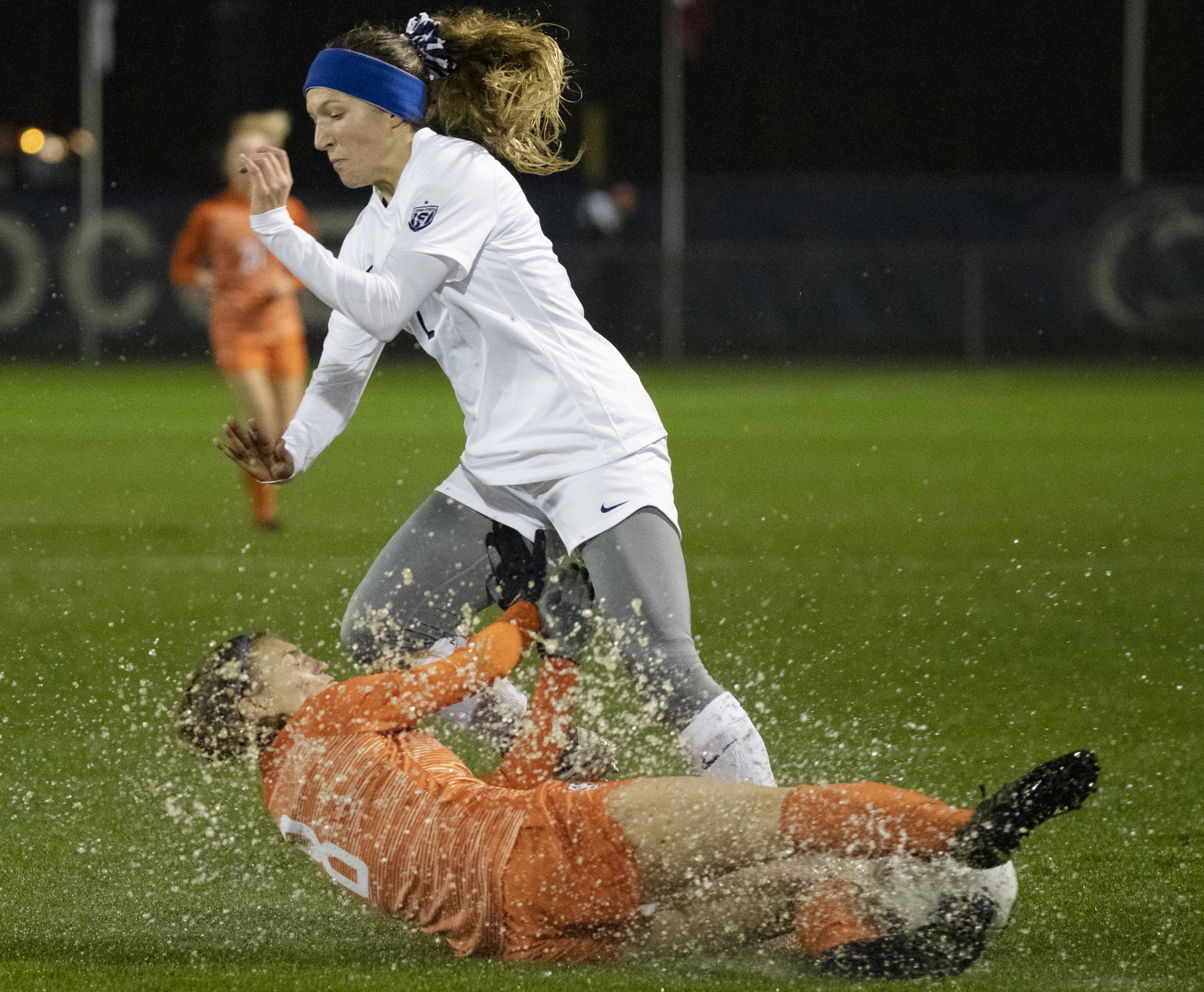 Forward Kerry Abello (2) get tackled during the NCAA tournament first round game against Bowling Green at Jeffrey Field on Friday, Nov. 9, 2018. The Nittany Lions defeat Bowling Green 4-1 and advance to the second round of the NCAA Tournament. | Photo by: Noah Riffe