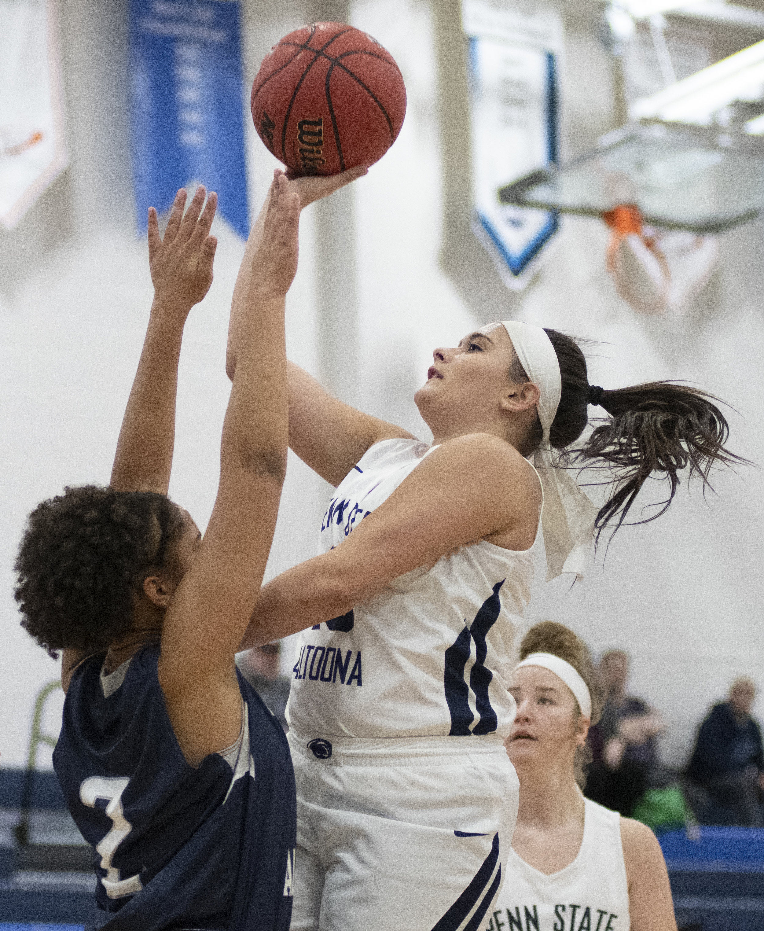 Finnley Christine (13) shoots the ball during their game against Mount Aloysius College at Adler Arena on Wednesday, Nov. 28, 2018. | Photo by: Noah Riffe