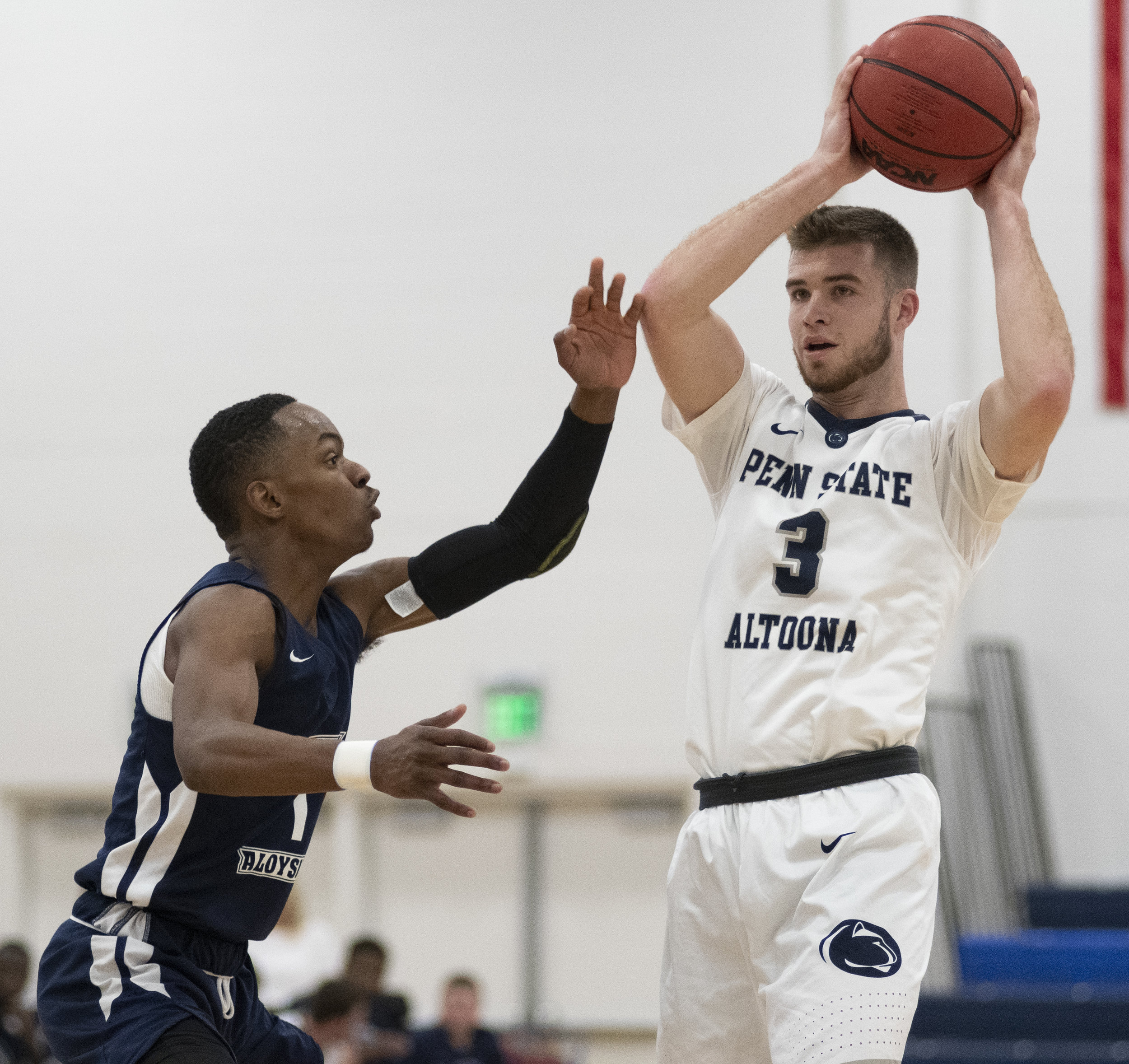 Austin Krise (3) looks for a pass during their game against Mount Aloysius College at Adler Arena on Wednesday, Nov. 28, 2018. | Photo by: Noah Riffe