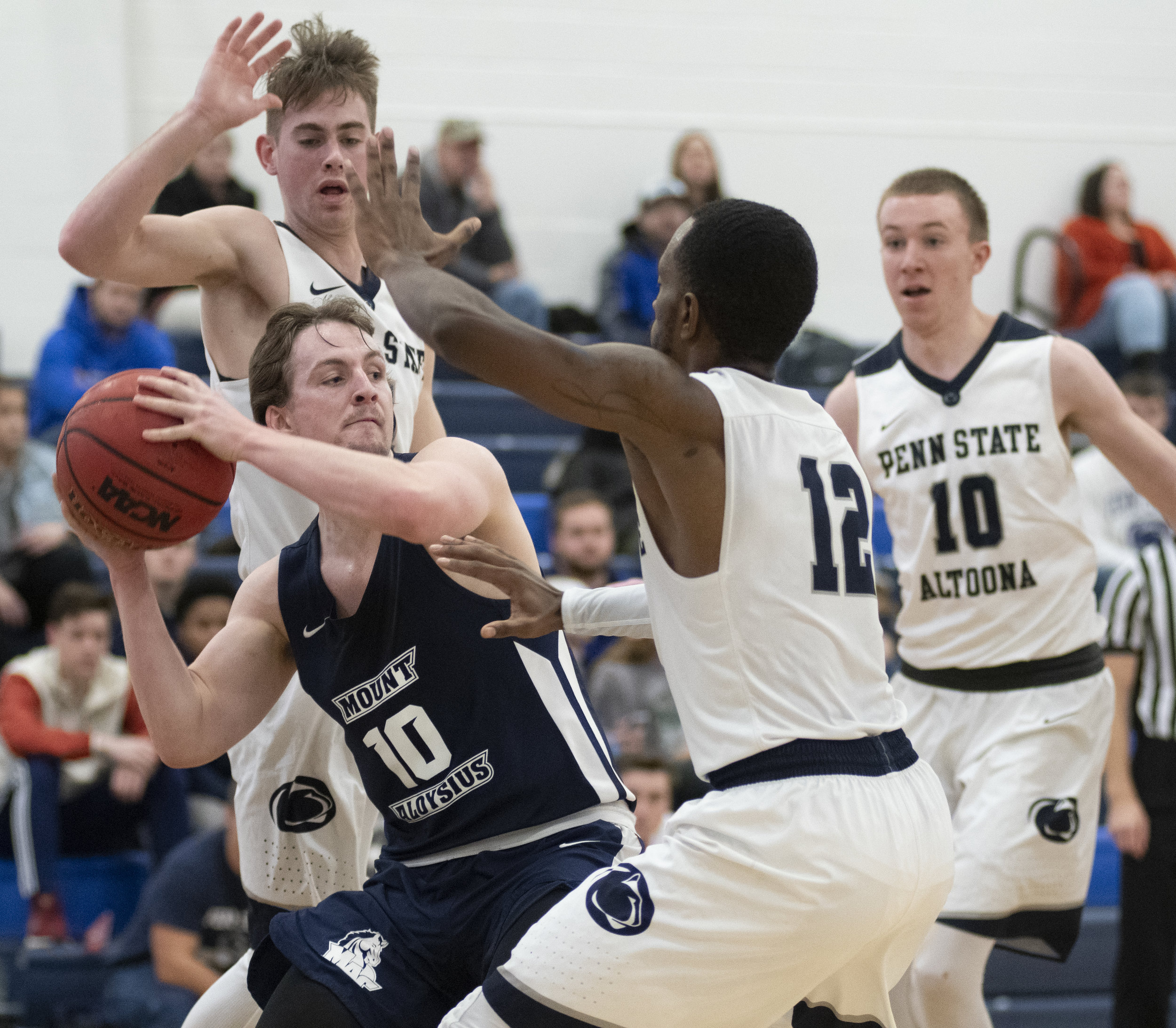 Jalen Archie-Davis (12) defends during their game against Mount Aloysius College at Adler Arena on Wednesday, Nov. 28, 2018. | Photo by: Noah Riffe