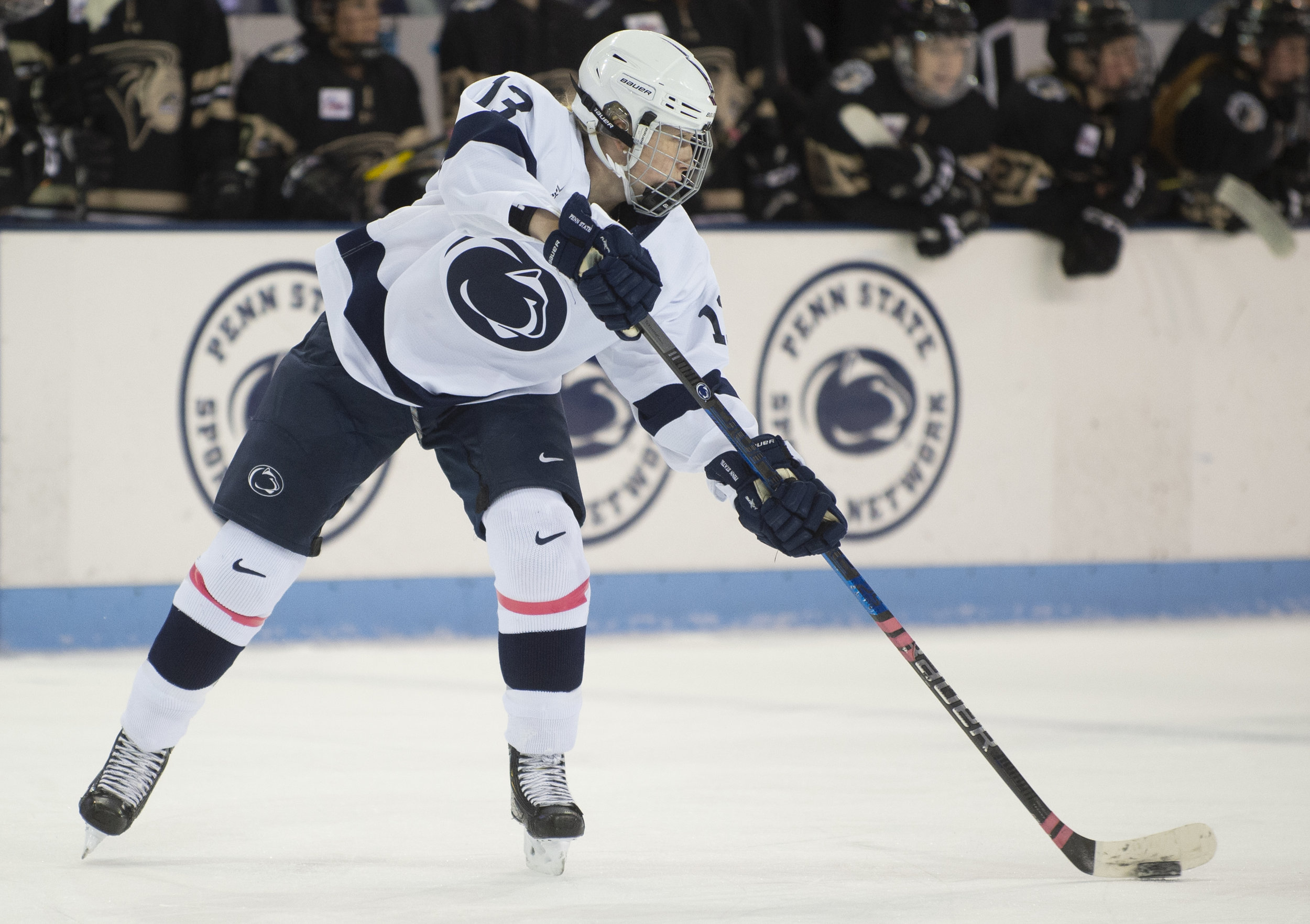 Defender Rene Gangarosa (13) passes the puck during the women's hockey game against Lindenwood at Pegula Ice Arena on Jan. 21, 2019. The Nittany Lions defeat Lindenwood 2-1 and secure a series sweep. - Photo by: Noah Riffe
