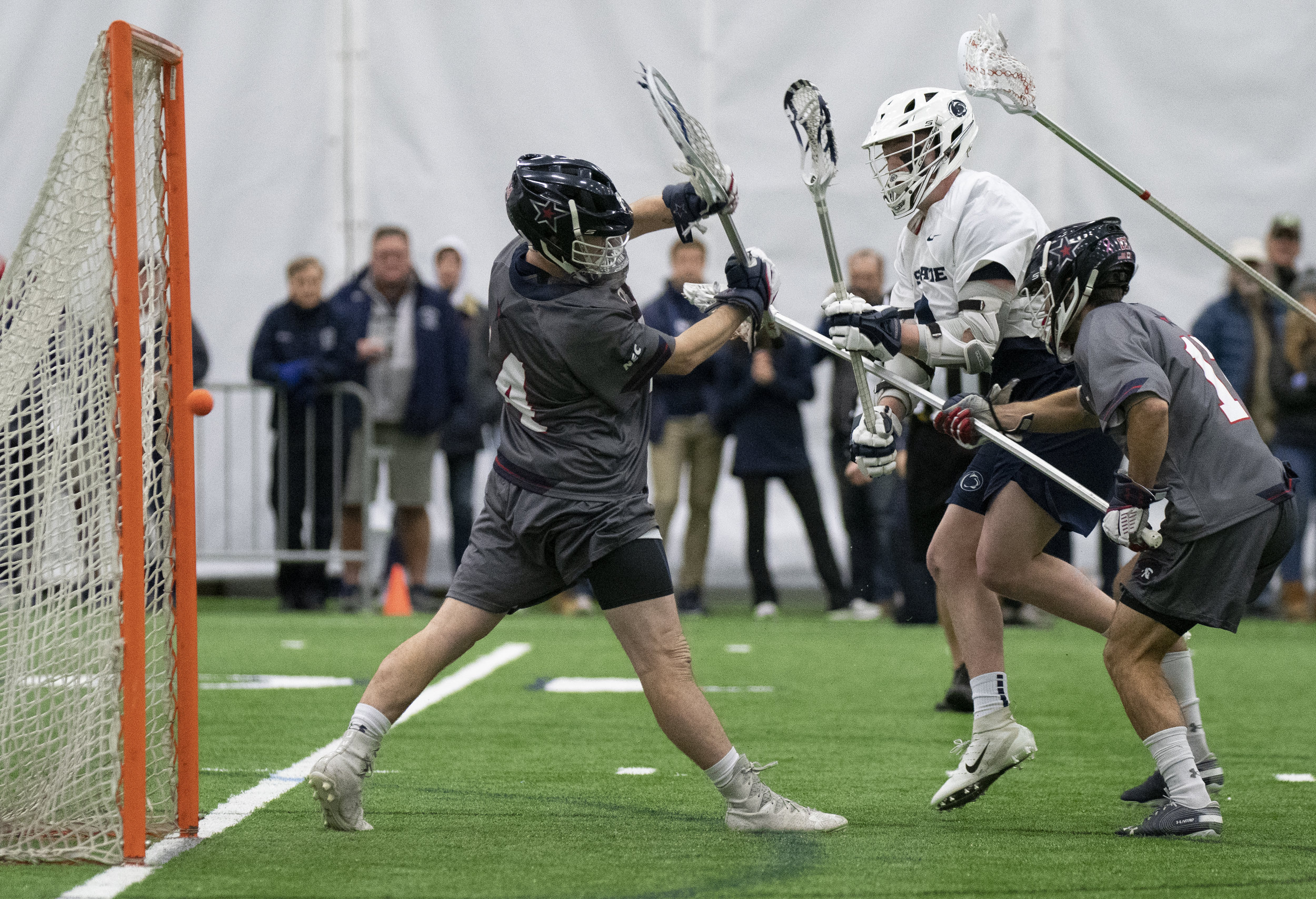 Attacker Mac O'Keefe (3) scores a goal during the men's lacrosse game against Robert Morris at Holuba Hall on Feb. 9, 2019. The Nittany Lions score a program record 27 points to rout Robert Morris 27-10. | Photo by: Noah Riffe