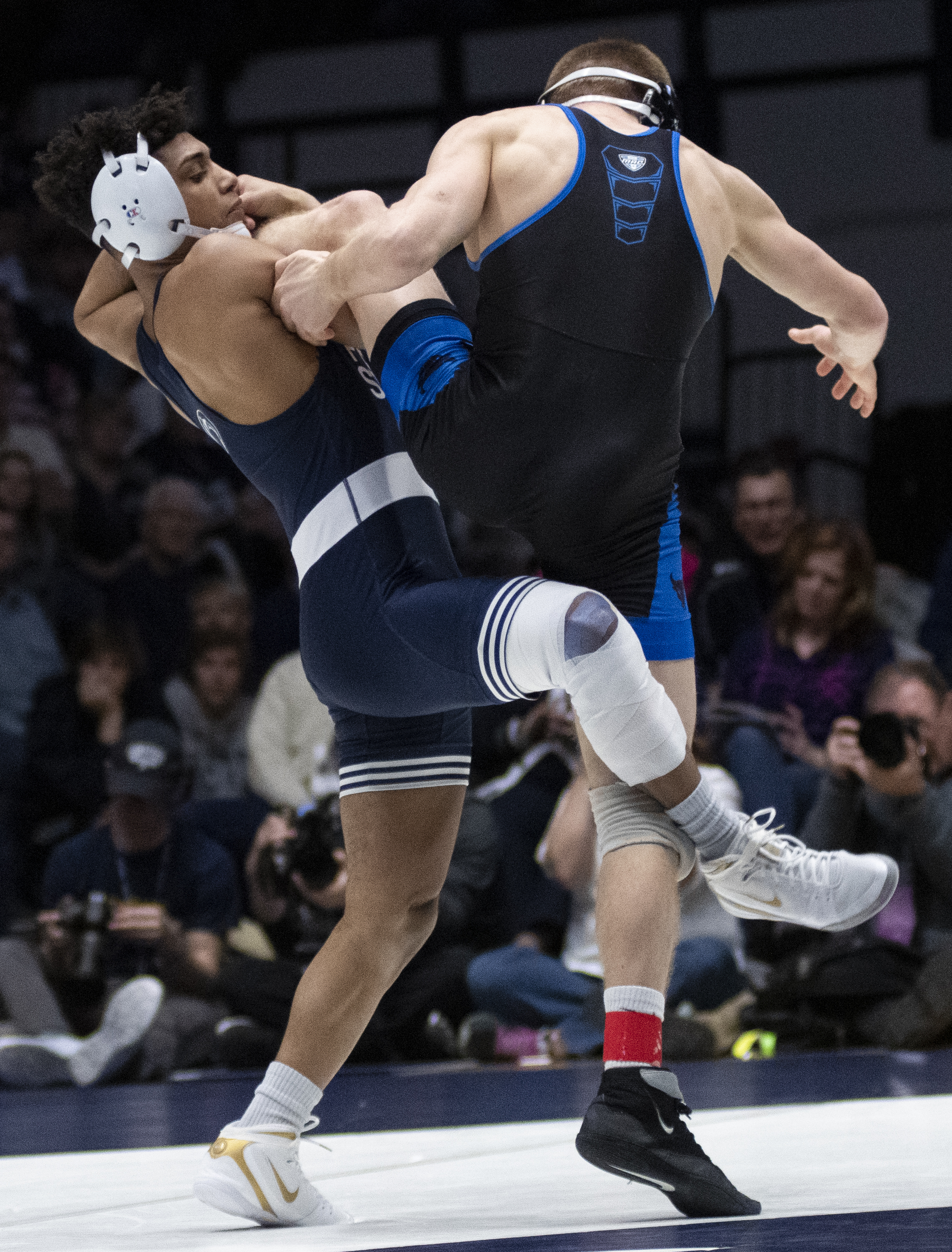 Justin Lopez attempts to take down Kyle Akins during the wrestling match against Buffalo at Rec Hall, Sunday, Feb. 24, 2019. On Senior Day, Penn State defeat Buffalo 47-3. | Photo by: Noah Riffe