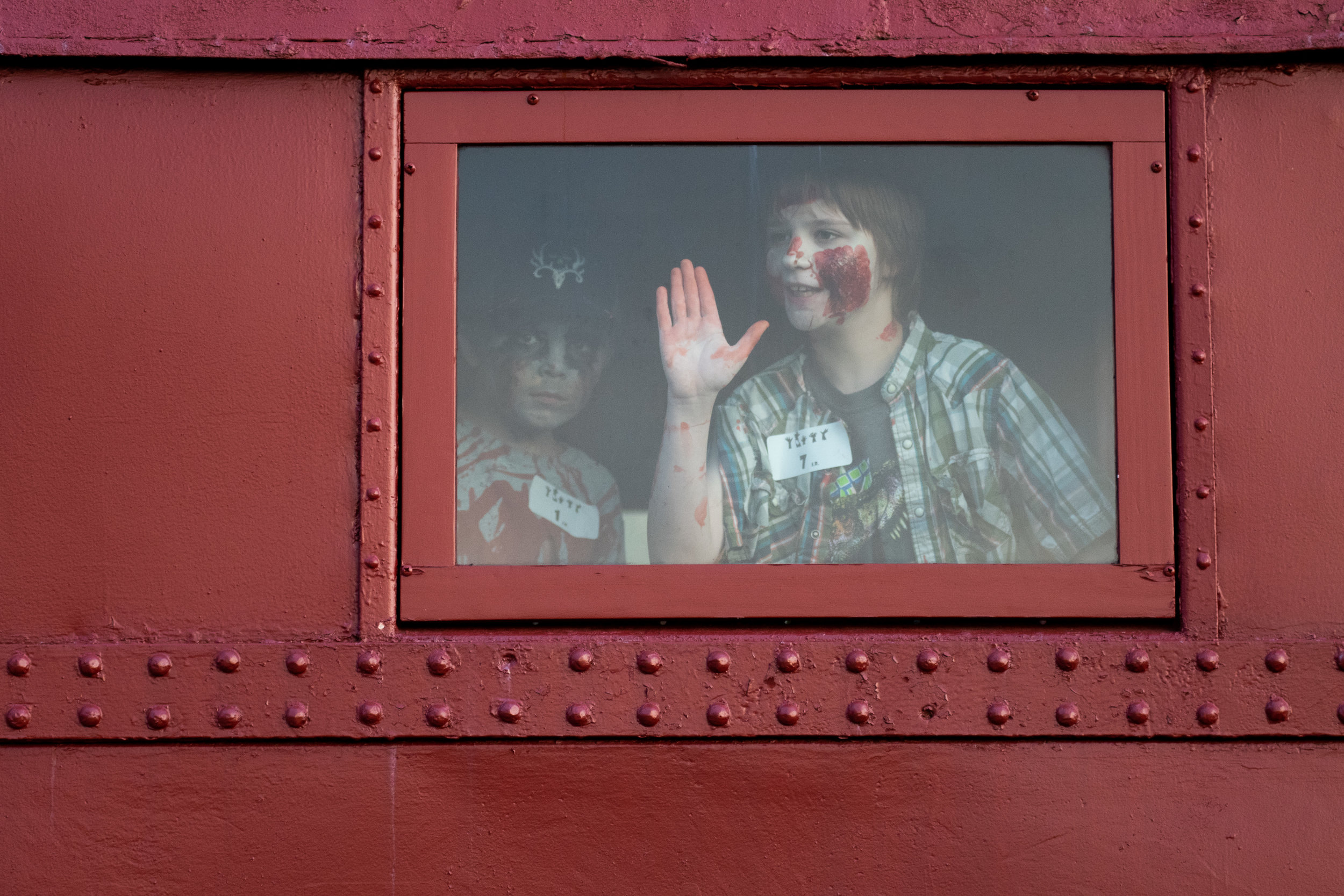 (Left to right) Ashten Coberoy, 8, and Connor Pierce, 11, of Altoona play in a rail car during the ZombieTown USA Zombie Prom at the Altoona Railroaders Memorial Museum on Friday, Oct. 5th, 2018.