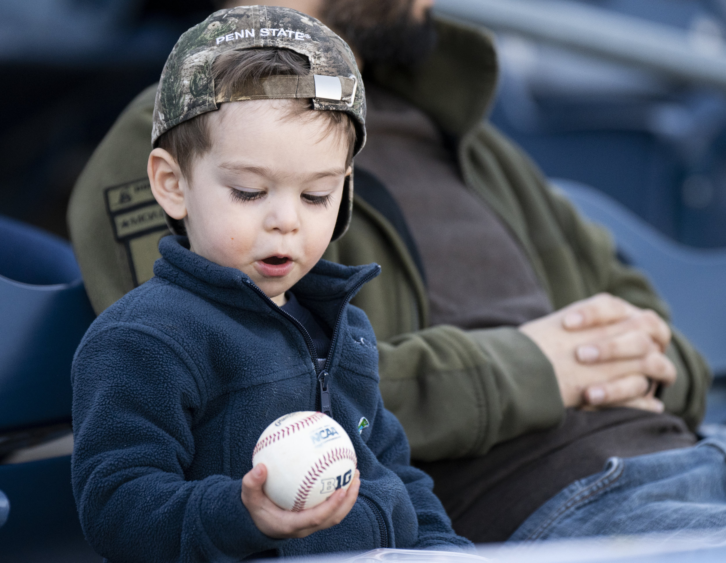 A fan receives a ball during the Penn State Baseball game on Friday, March 15, 2019 at Medlar Field. | by: Noah Riffe