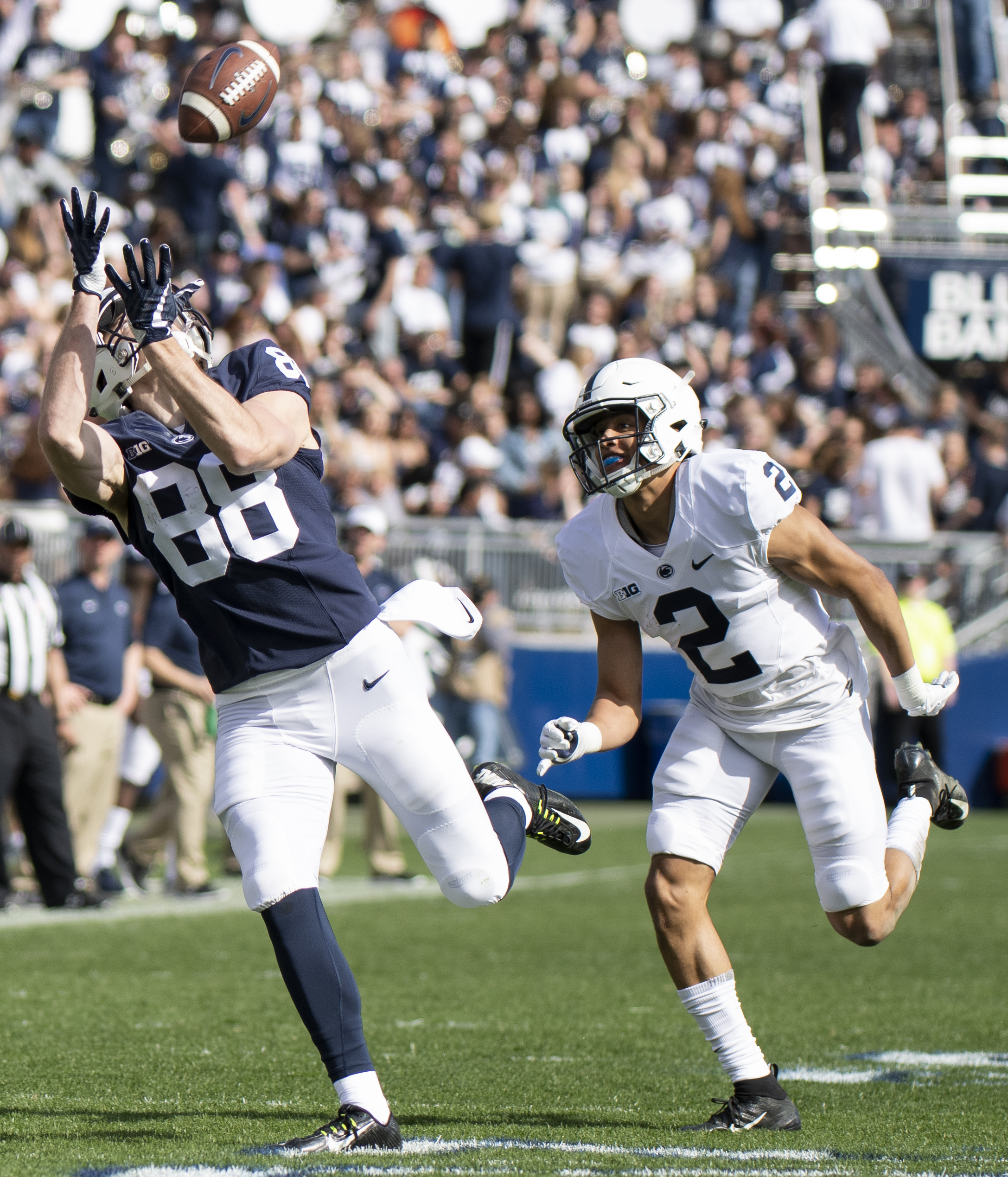 Wide receiver Dan Chisena (88) catches a 59-yard touchdown catch during the Penn State Blue-White game at Beaver Stadium on Saturday, April 13, 2019. With this catch the team presented him with a full scholarship. | Photo by: Noah Riffe