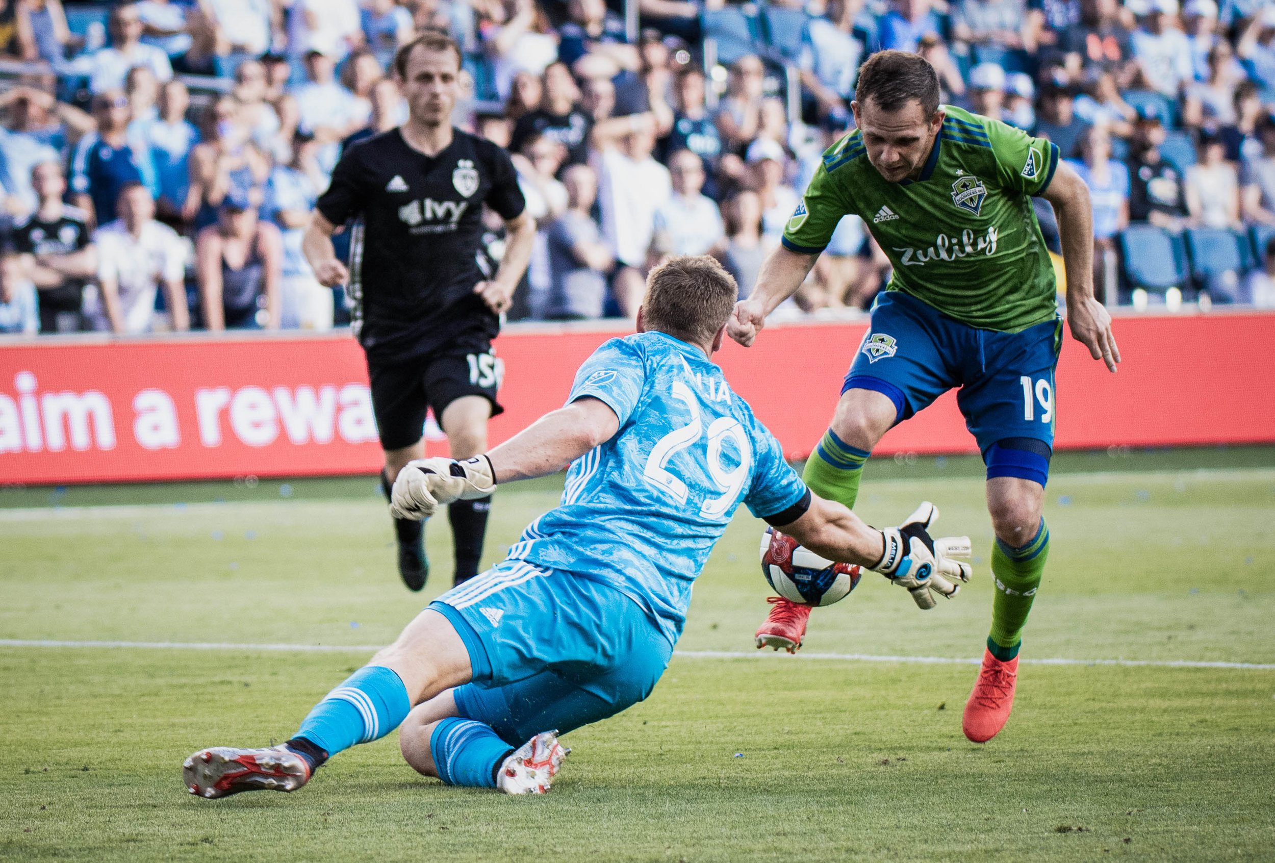 Tim Melia (29) makes a save during Sporting Kansas City's match against Seattle Sounders FC on Sunday, May 26, 2019 at Children's Mercy Park in Kansas City, Kansas. Sporting defeated the Sounders 3-2. (Photo by: Noah Riffe)