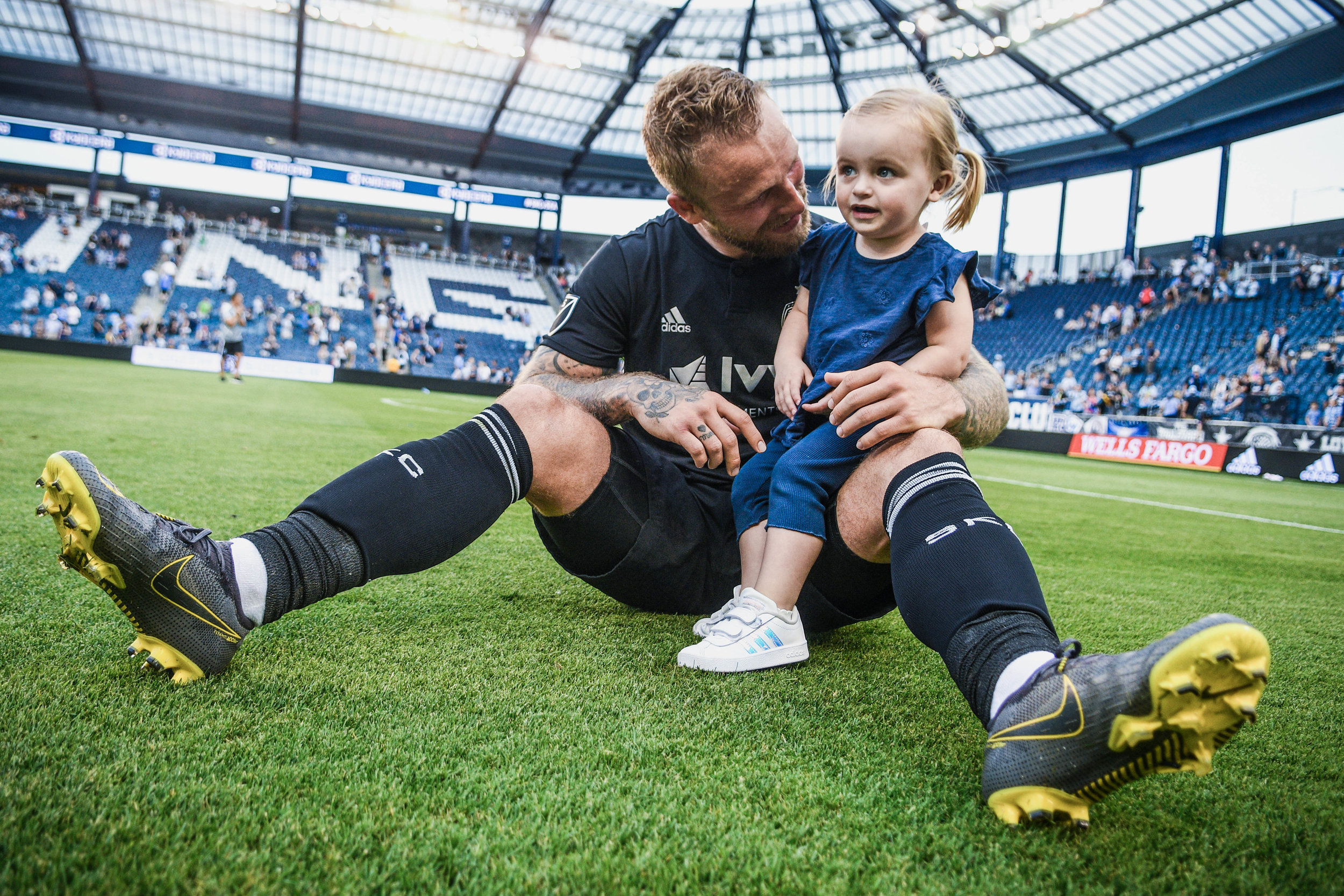 Johnny Russell (7) hugs his daughter after Sporting Kansas City's match against Seattle Sounders FC on Sunday, May 26, 2019 at Children's Mercy Park in Kansas City, Kansas. Sporting defeated the Sounders 3-2. (Photo by: Noah Riffe)