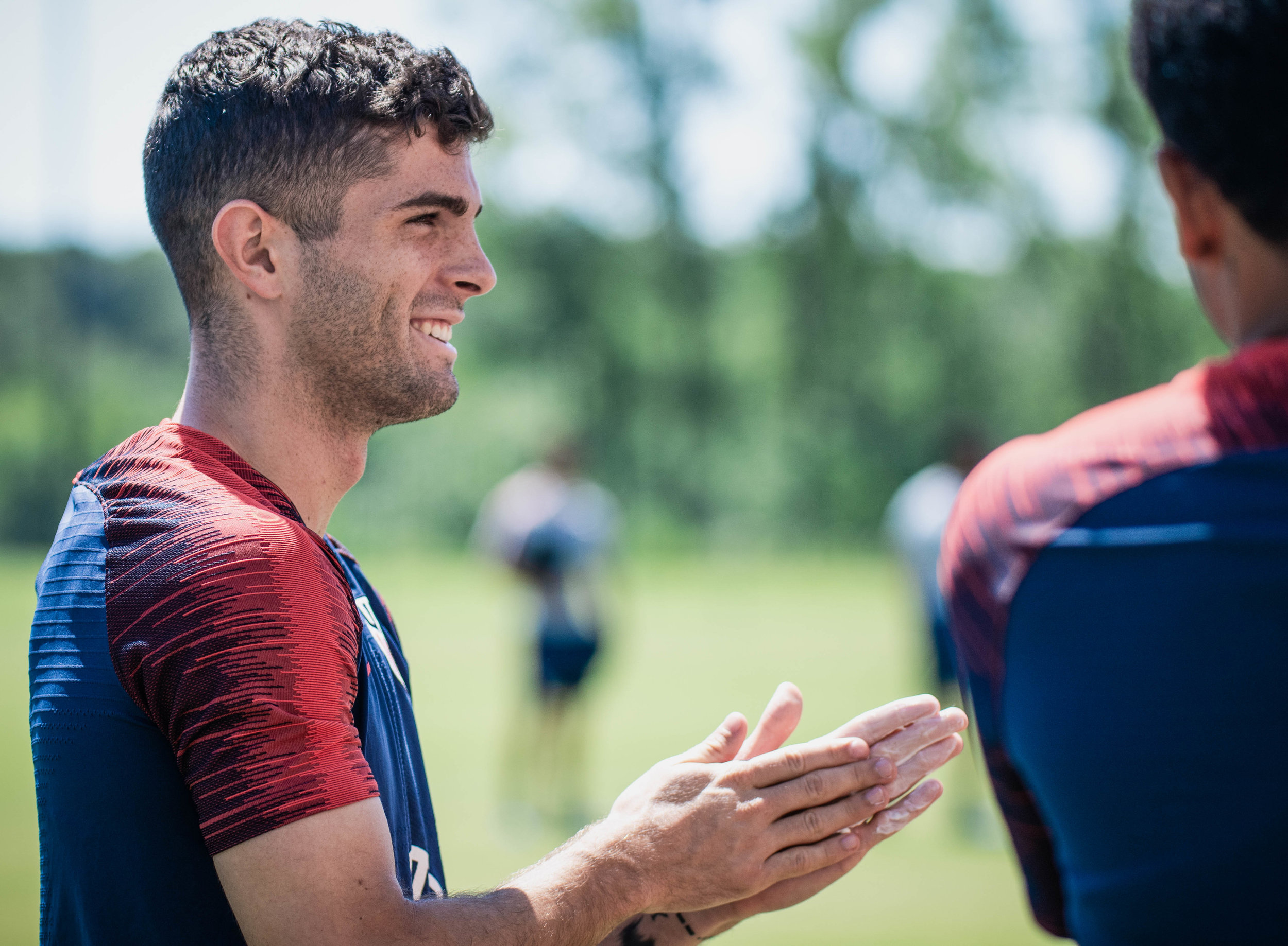 Christian Pulisic puts on sunscreen during the U.S. Men's National Team, Gold Cup training session on Tuesday, June 25, 2019 at Pinnacle National Development Center in Kansas City, Kansas. The U.S. Men's National Team will face off with Panama in the team's final group stage match of the Gold Cup. | Photo by: Noah Riffe