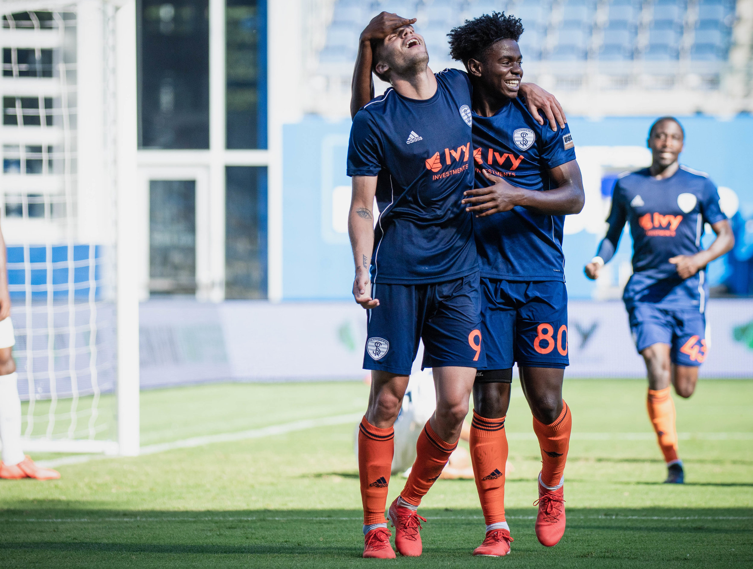 Ethan Vanacore-Decker (91) celebrates with Sean Karani (80) after scoring in the Swope Park Rangers vs. Saint Louis FC match on Sunday, June 30, 2019 at Children's Mercy Park in Kansas City, Kansas. The Rangers took down Saint Louis 2-1 breaking their 8 game winless streak.