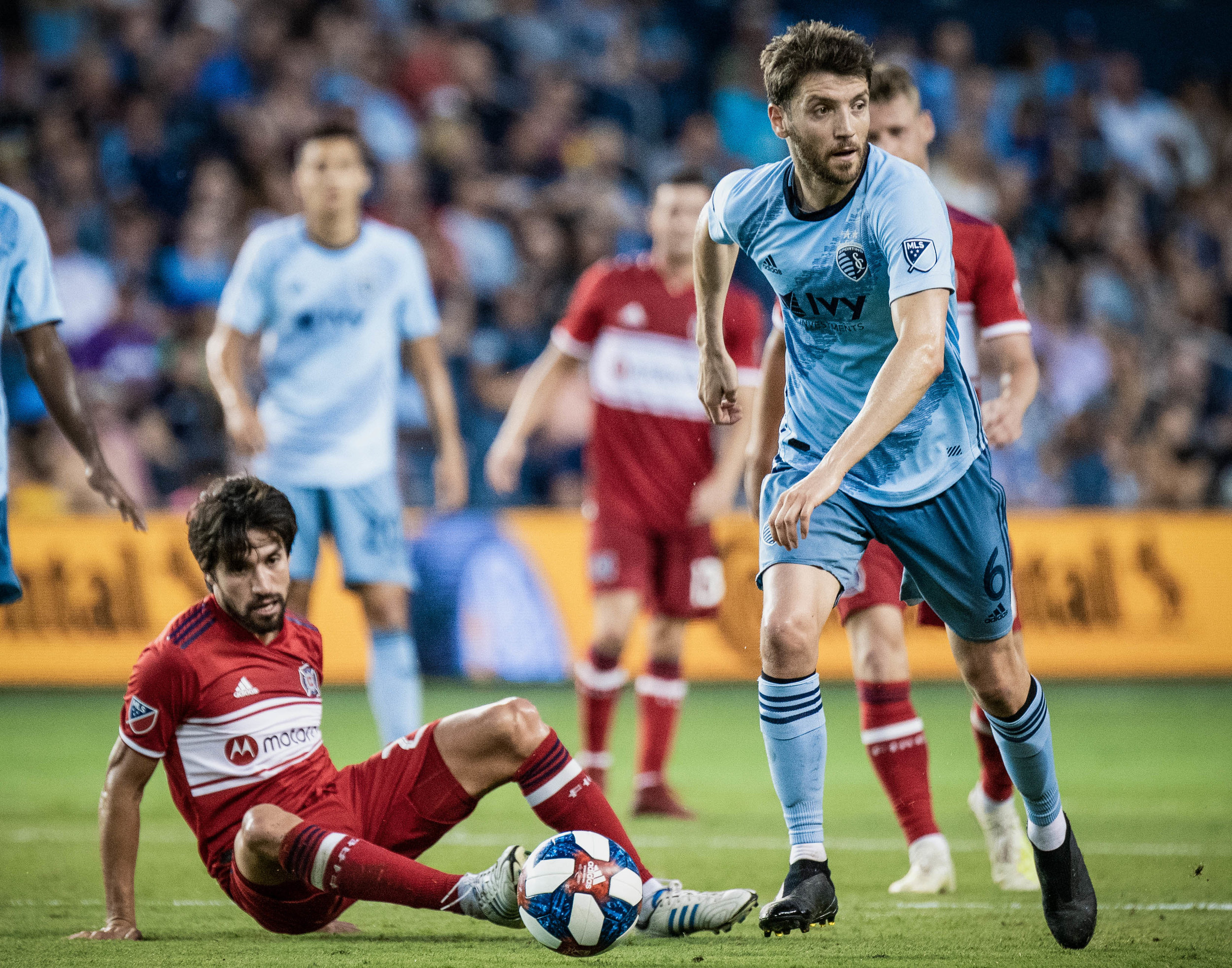 Ilie Sánchez (6) dribbles past a defender during the Sporting Kansas City vs. Chicago Fire match on Saturday, July 6, 2019 at Children's Mercy Park in Kansas City, Kansas. Sporting defeated the Fire 1-0.