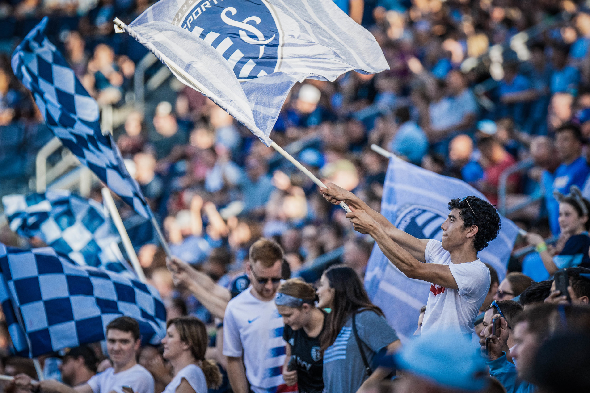 A fan waves a flag during the Sporting Kansas City vs. Chicago Fire match on Saturday, July 6, 2019 at Children's Mercy Park in Kansas City, Kansas. Sporting defeated the Fire 1-0.