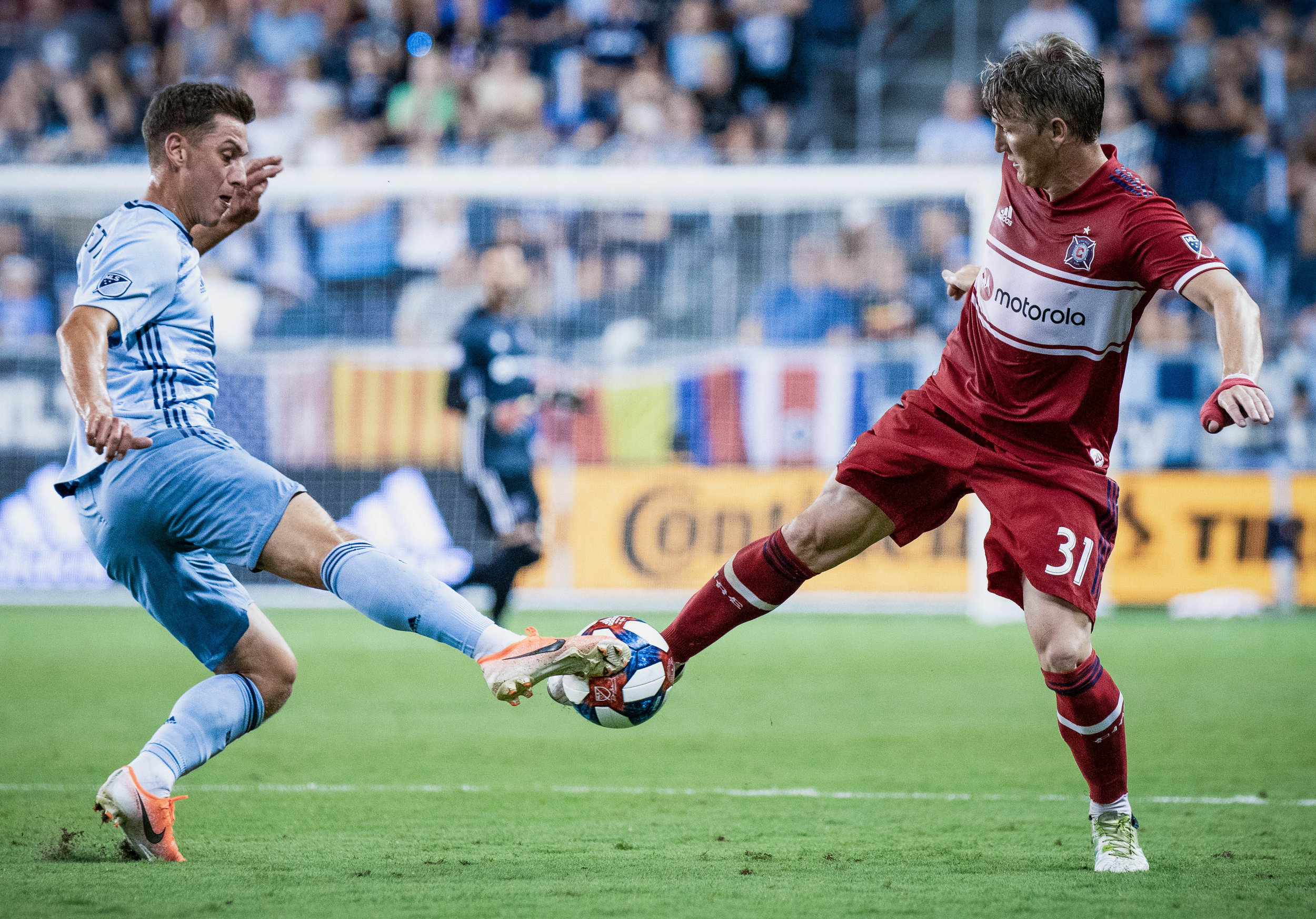 Krisztián Németh (11) fights for the ball with Bastian Schweinsteiger (31) during the Sporting Kansas City vs. Chicago Fire match on Saturday, July 6, 2019 at Children's Mercy Park in Kansas City, Kansas. Sporting defeated the Fire 1-0.