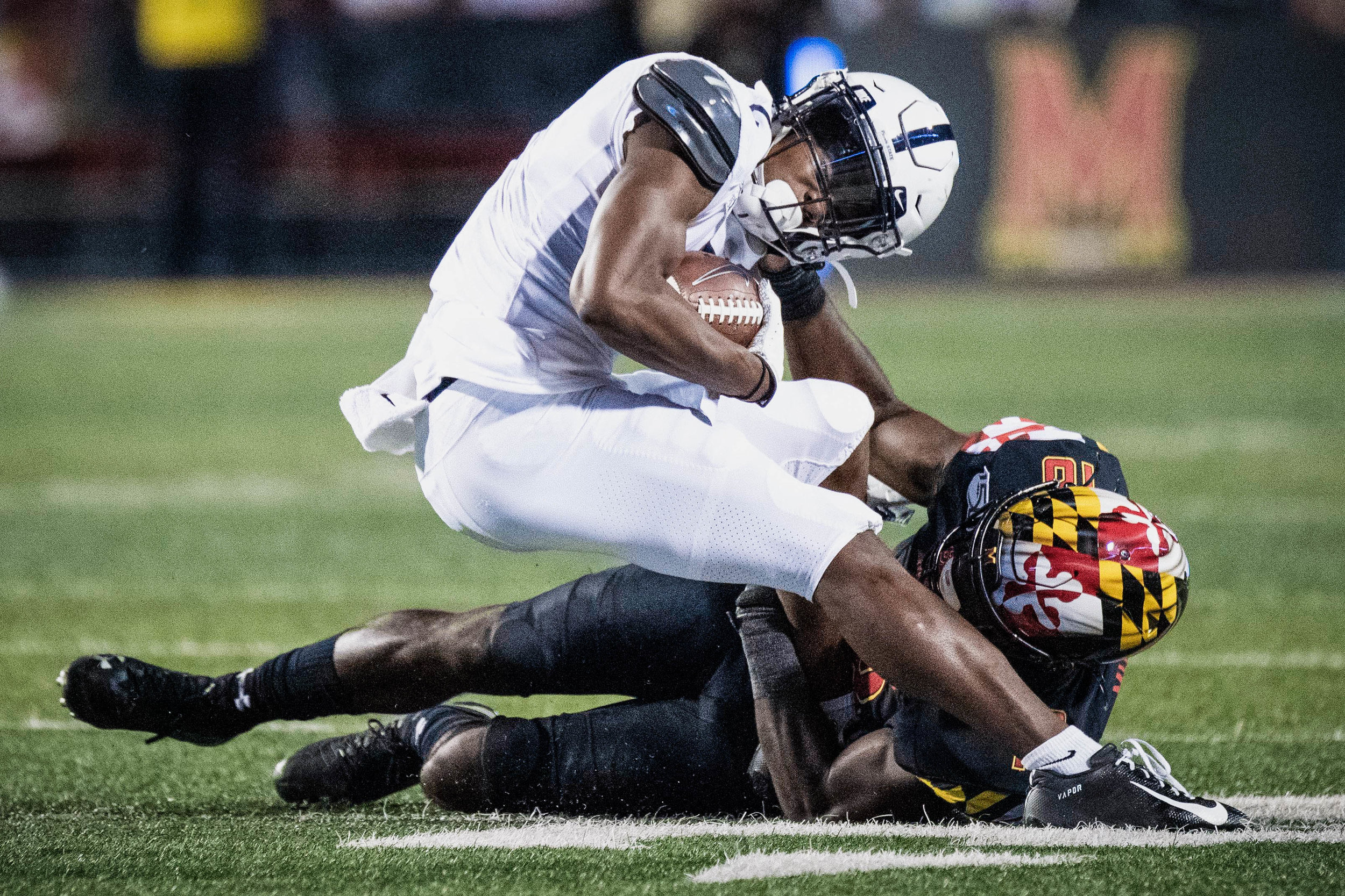 Maryland Terrapins defensive back Jordan Mosley (18) grabs the helmet of Penn State Nittany Lions wide receiver Jahan Dotson (5) during the game against Maryland on Friday, Sept. 27, 2019 at Capital One Field in College Park, Md. The Nittany Lion's defeated the Terrapins 59-0. | Photo by: Noah Riffe