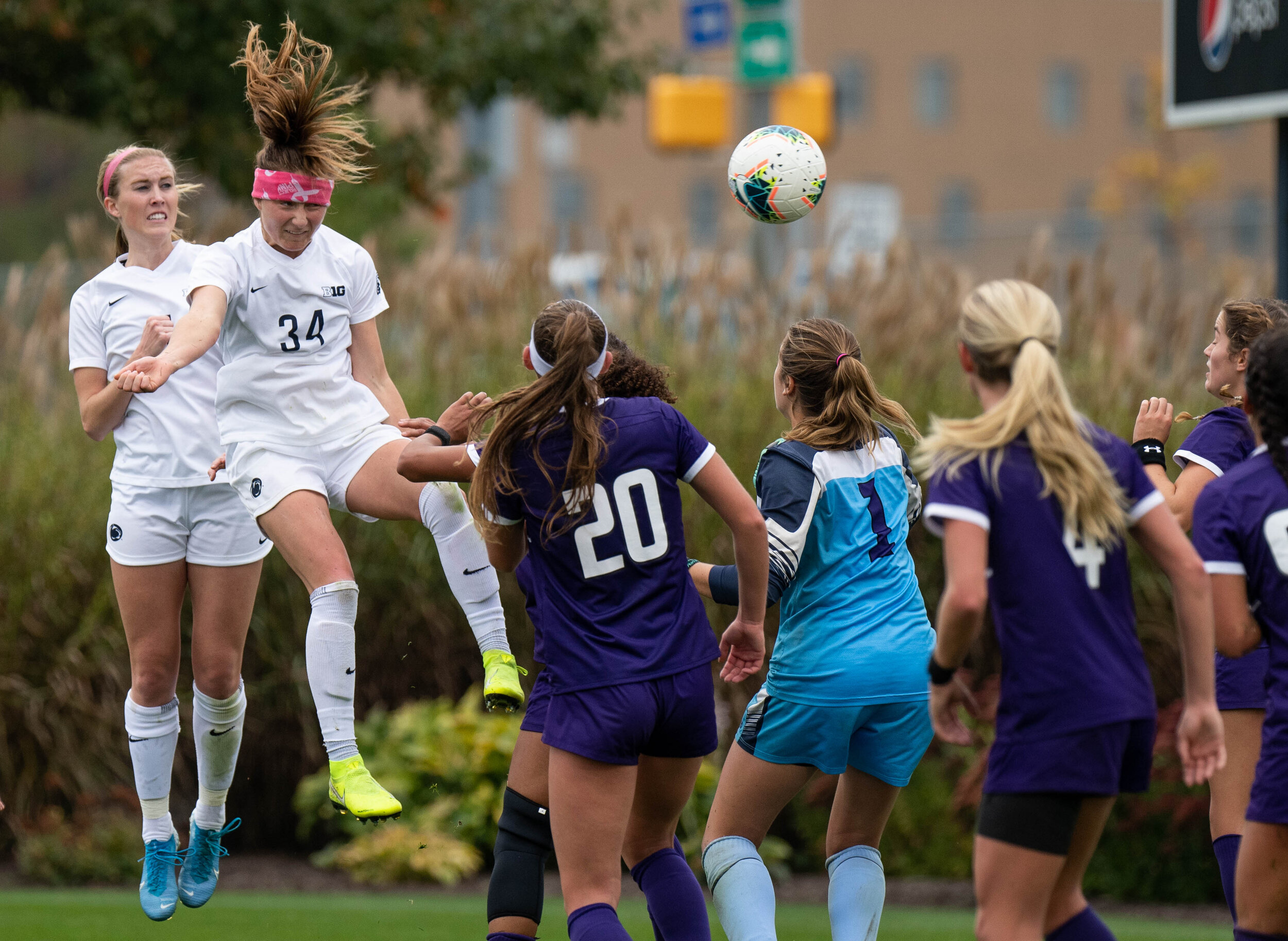 Midfielder, Ally Schlegel (34) heads the ball and scores a goal during the match against Northwestern on Sunday, Oct. 20, 2019 at Jeffrey Field. | Photo by: Noah Riffe