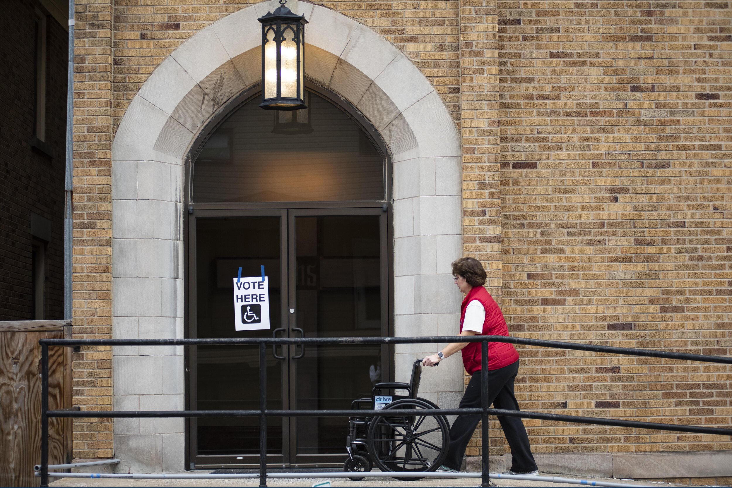 Cindy Kelley, of Altoona, Pa. pushes a wheelchair into the poling place at Bethany Lutheran Church on Tuesday, Nov. 5, 2019 in Altoona, Pa. | Photo by: Noah Riffe