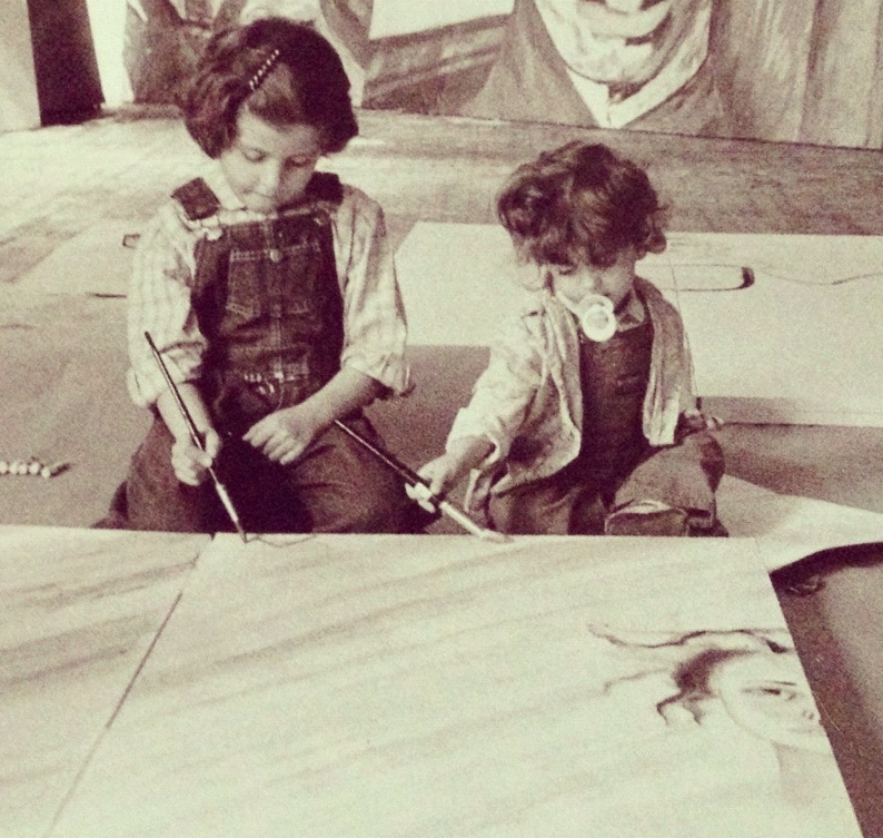 With little sister Nina, in their father's studio