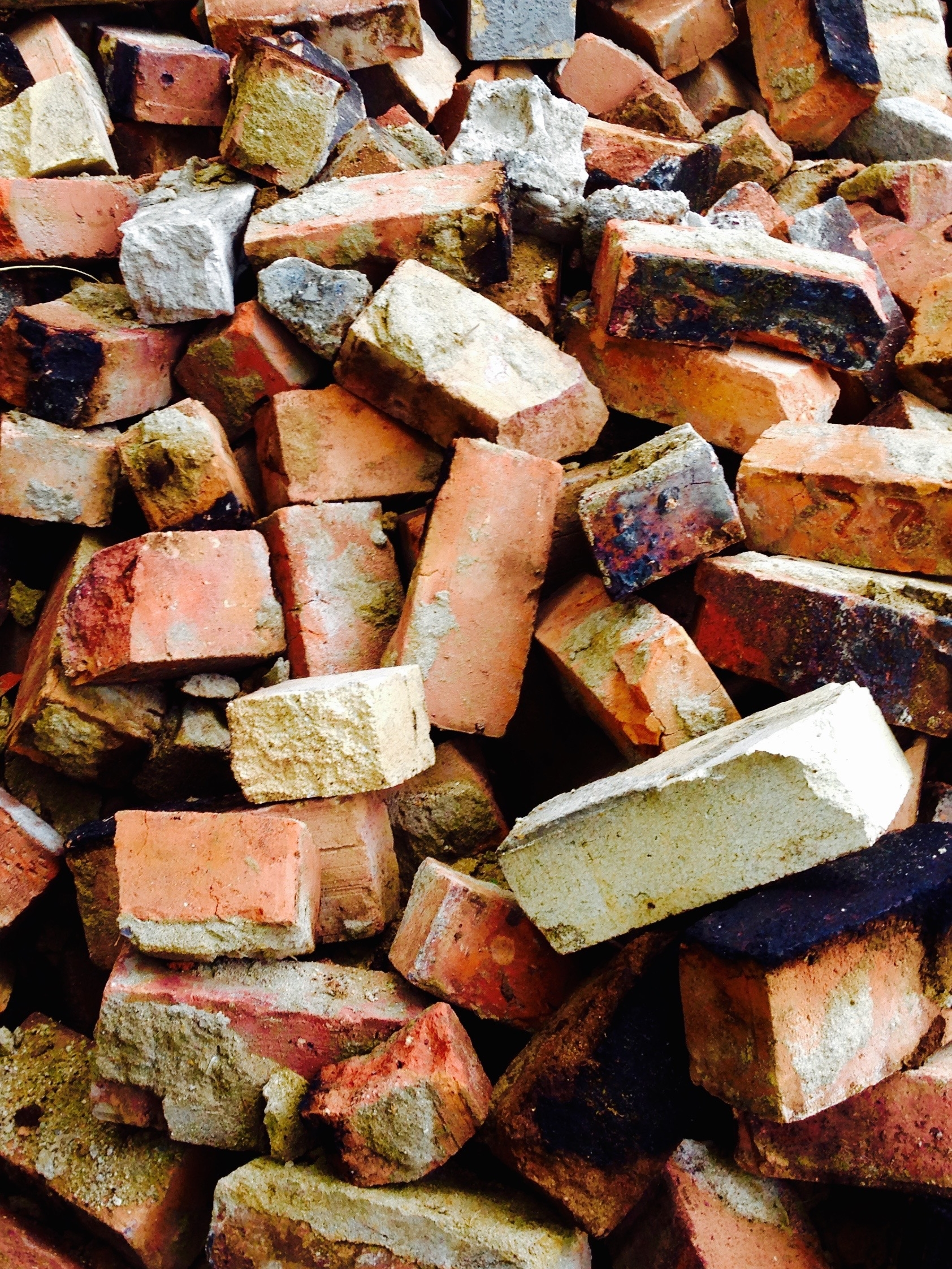 """The Bricks were part of the character of the house and we selected the best ones for reuse from the pile post chimney """"deconstruction"""""""