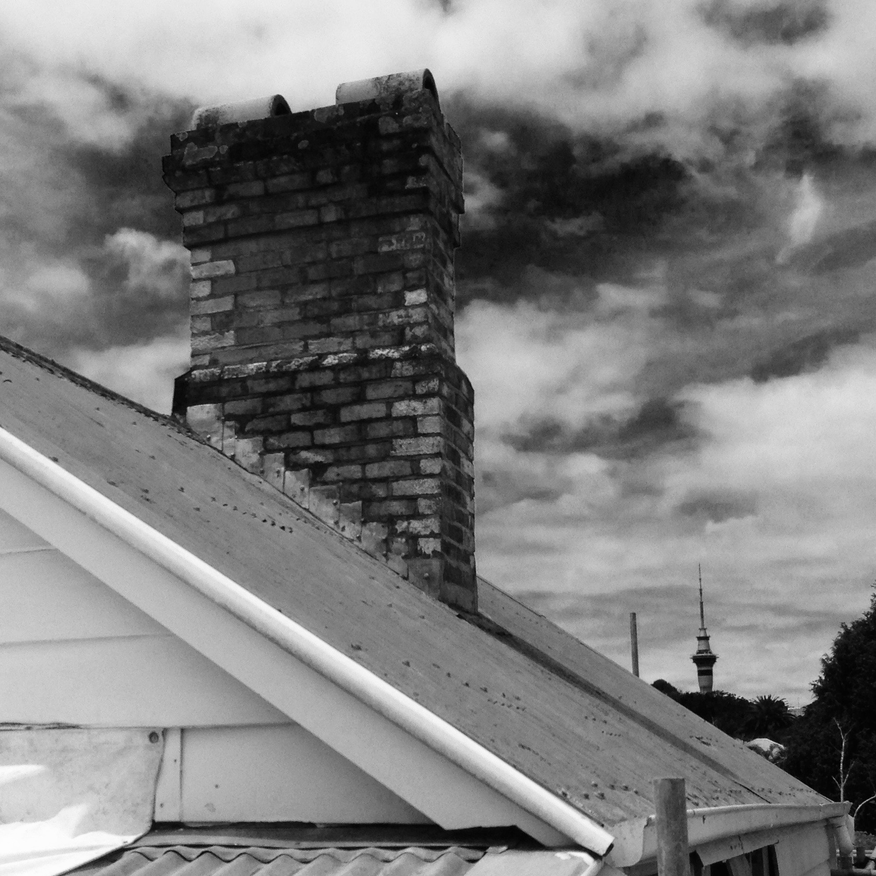 The old chimney was structurally unstable and needed to be removed -there was also evidence of both leaks and fire break out in the roof space!