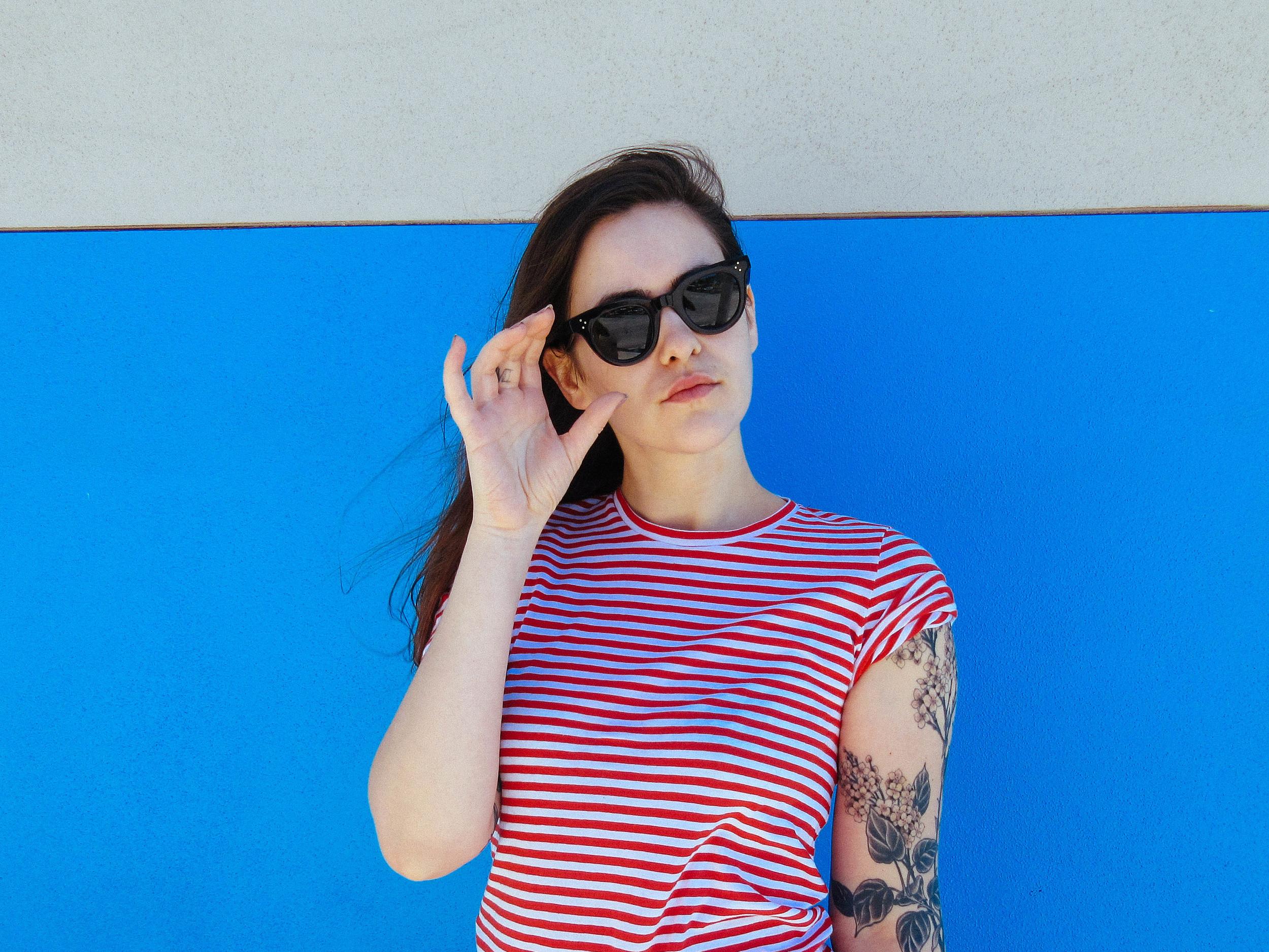 Everlane  medium striped crew and Céline sunglasses.