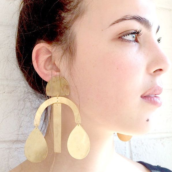 Annie Costello Brown  gold arc drop earrings, $255