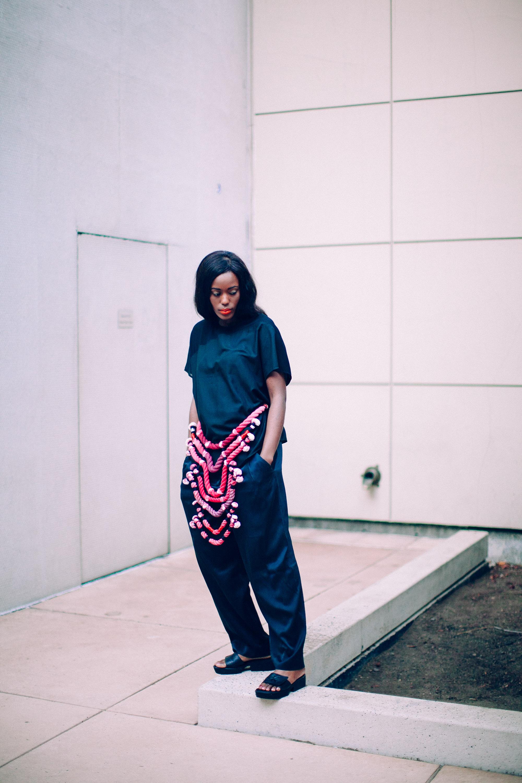"Photographer: Cecilia Corsano  Model: Anita Mwiruki  Wearing the ""Blood Champagne"" necklace"