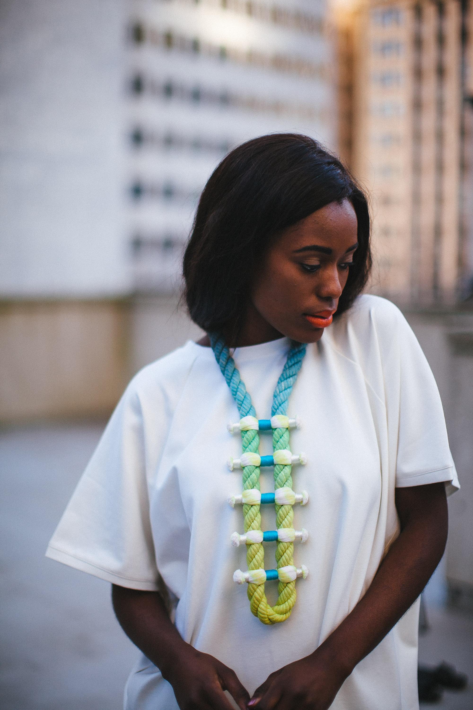 "Photographer: Cecilia Corsano  Model: Anita Mwiruki  Wearing the ""Layback""necklace"