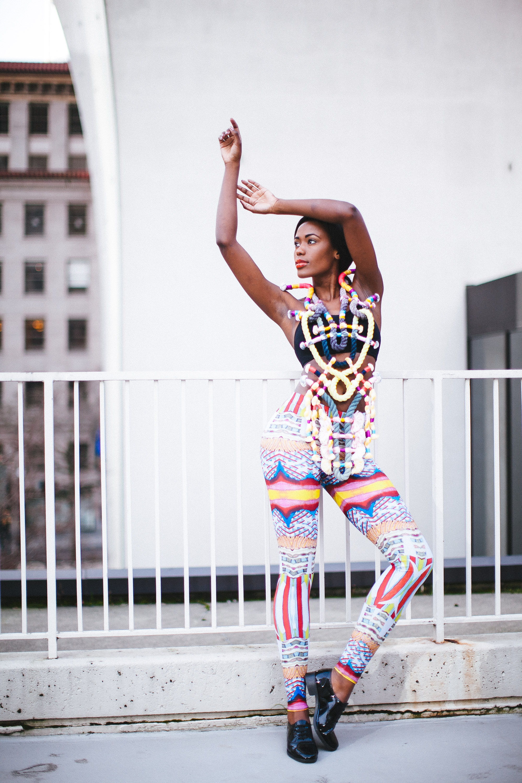 "Photographer: Cecilia Corsano  Model: Anita Mwiruki  Wearing the ""Mourning Bird"" necklace"