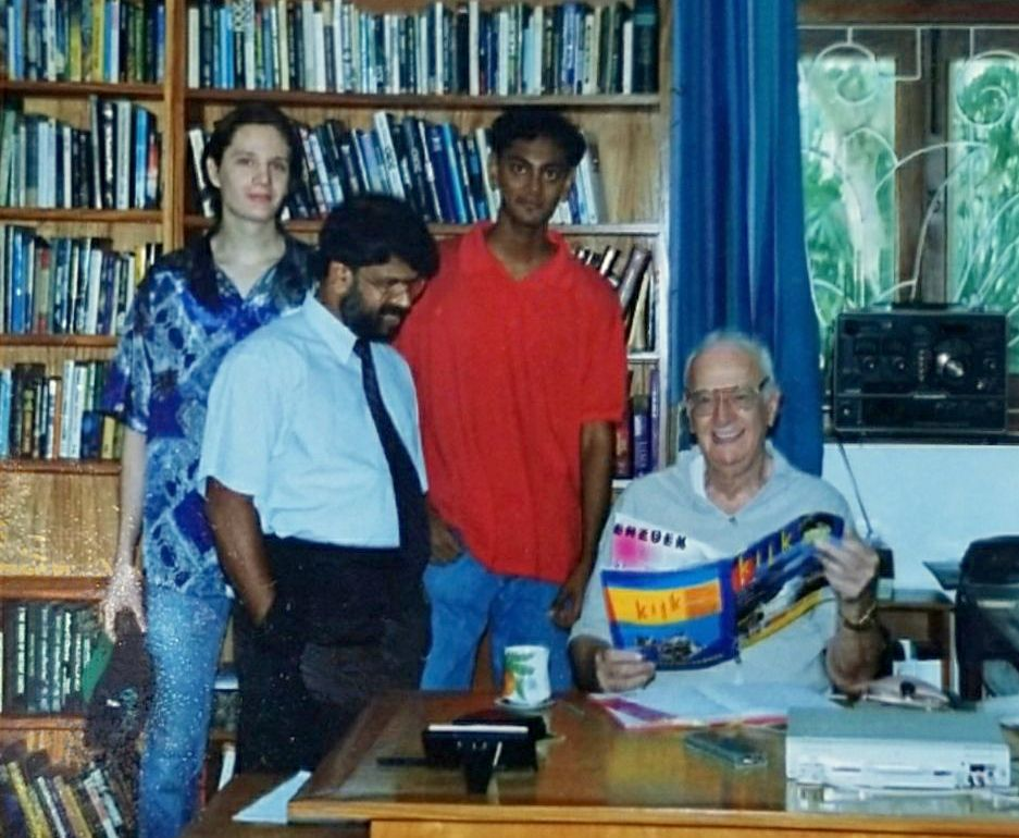 Me at 17, with my buddy Constantin, the school librarian, and Dr. Clarke.