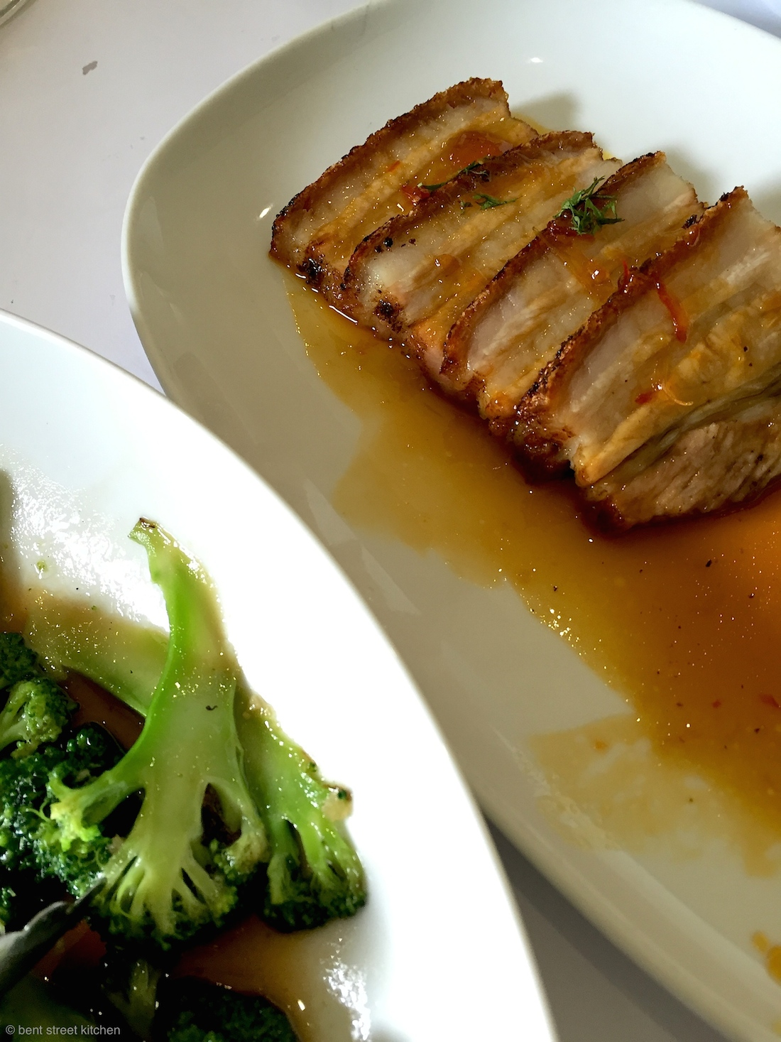 Barossa Hampshire pork belly with ginger and orange sauce and stir-fried seasonal vegetables with garlic & fish sauce