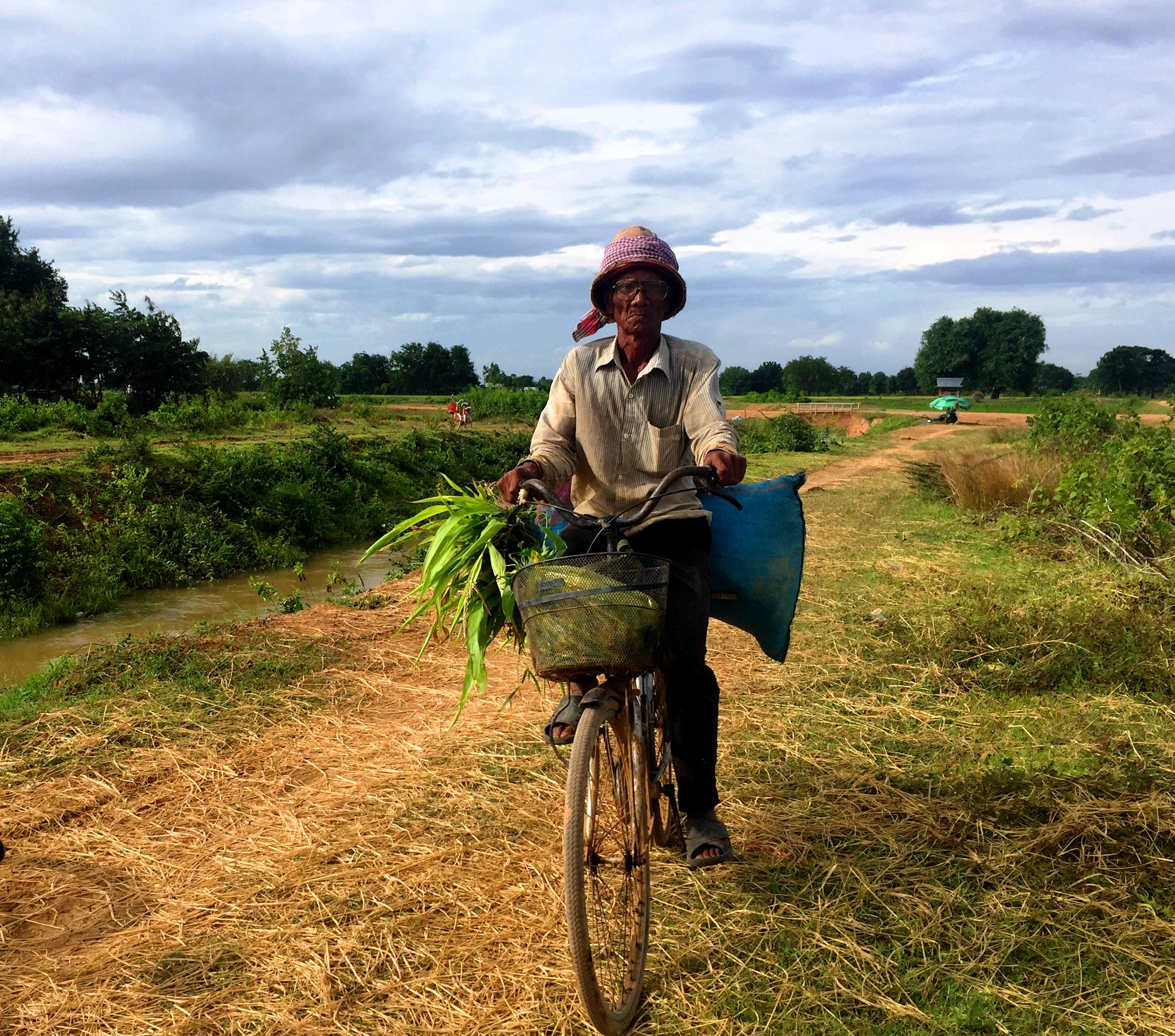 Farmer Riding Bicycle