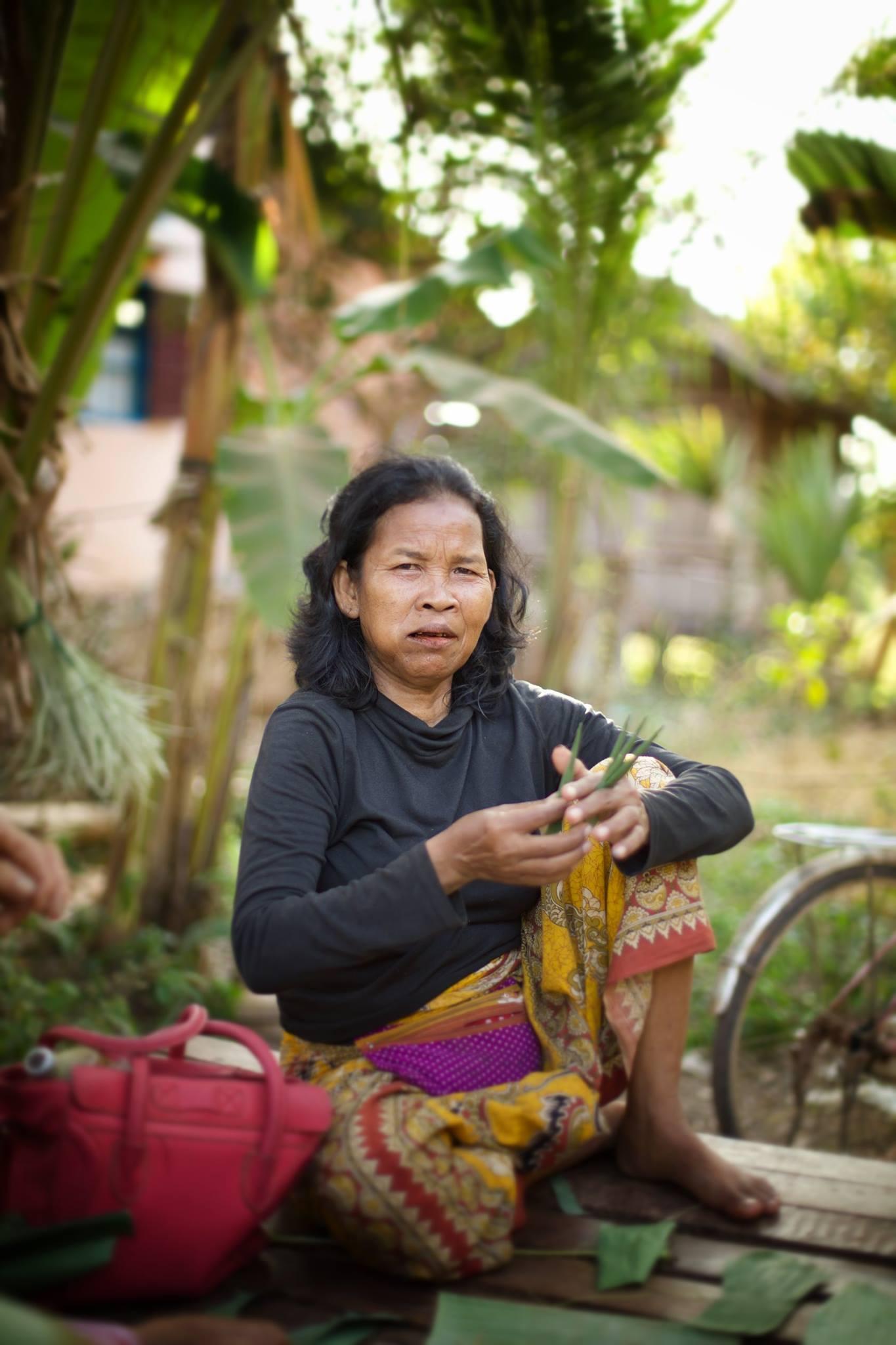 A Cambodian lady, holding banana leave, Battambang.