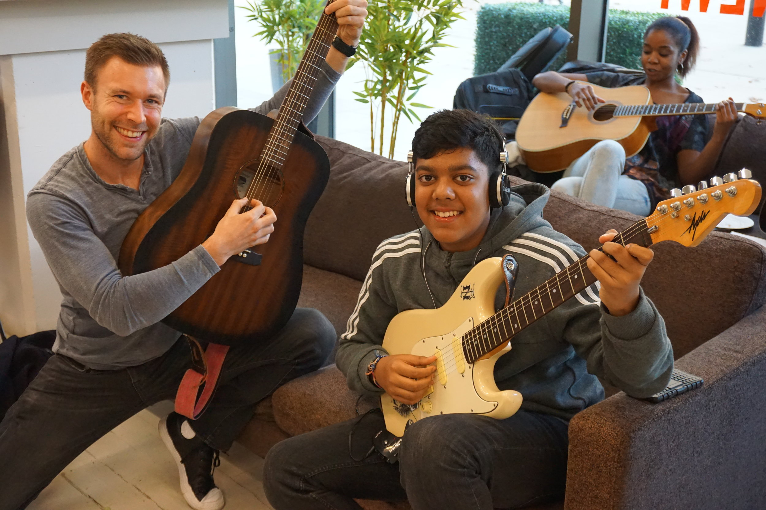 Meet new guitar friends! Two student, Tom and Hrydai who are both our guitar students sharing a love of movies at one of our events.