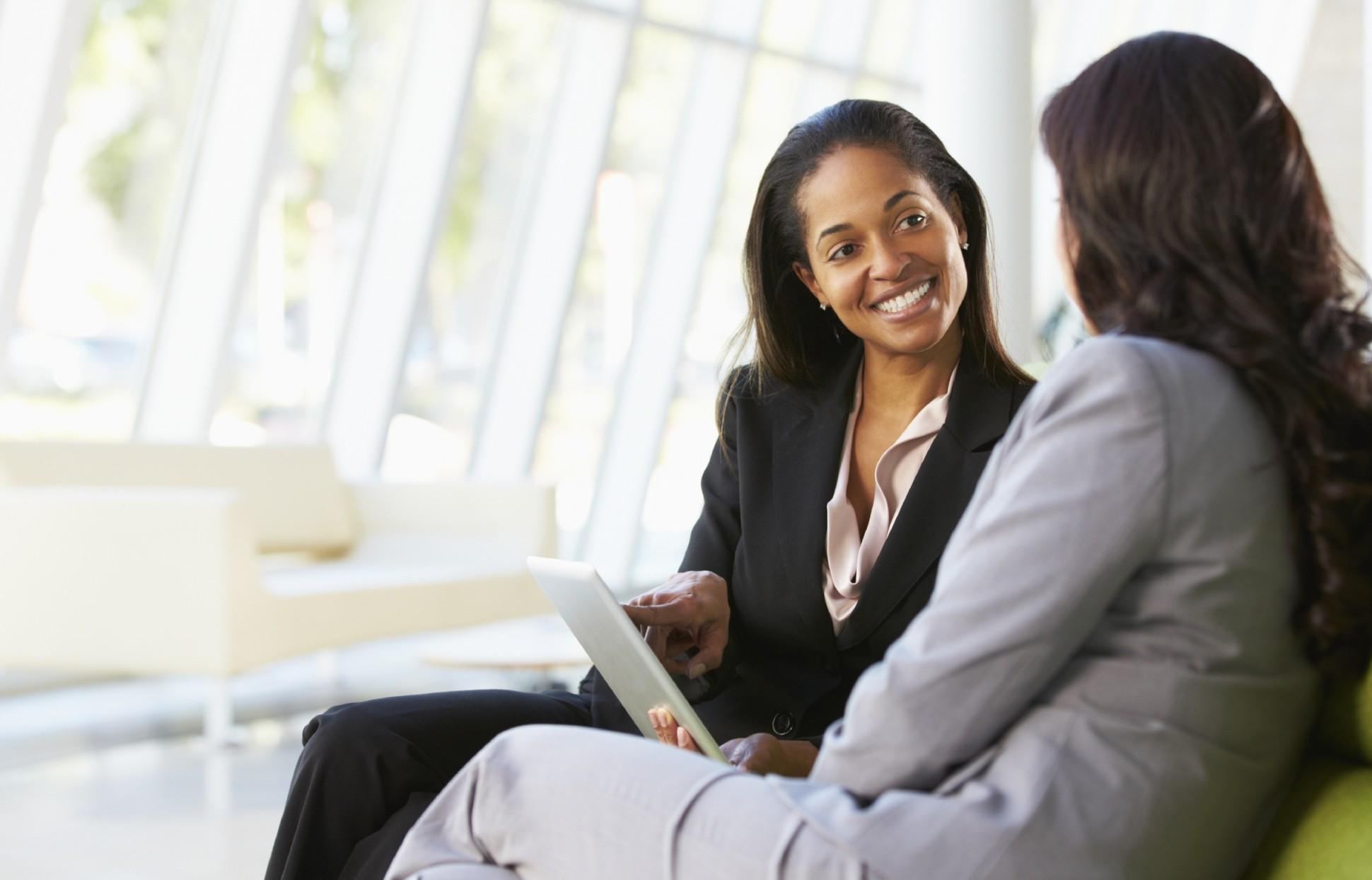 Coaching with tablet Businesswomen-With-Digital-Tablet-Sitting-In-Modern-Office-1940x1244.jpg