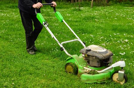 30121309_S_mower_man_walking_grass_cutting.jpg