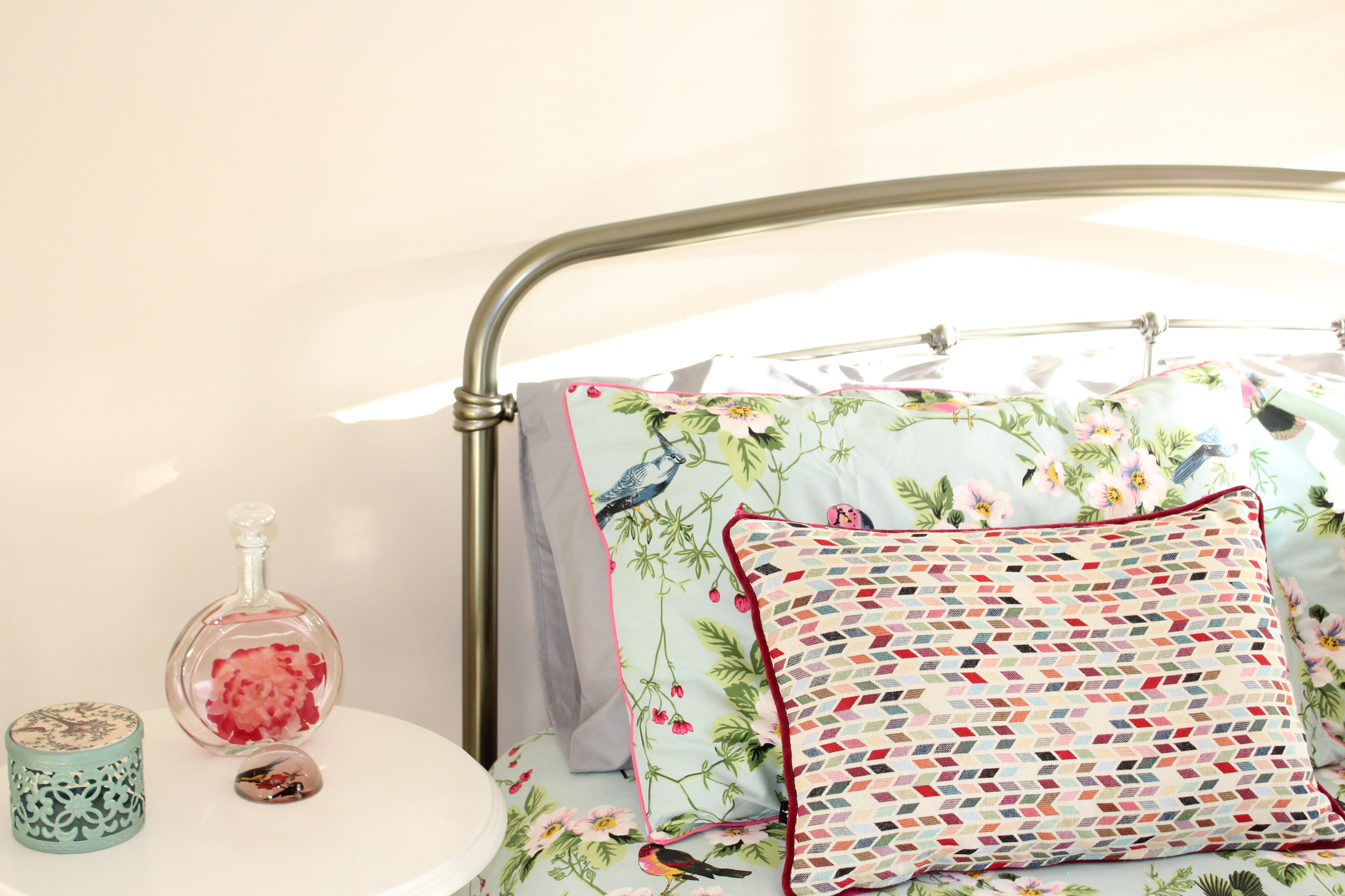 bright bedroom with accesories and pop of colour