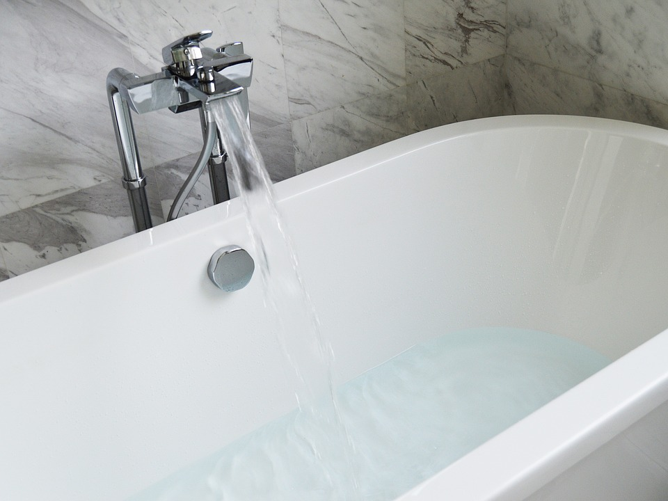 Freestanding bath with tap