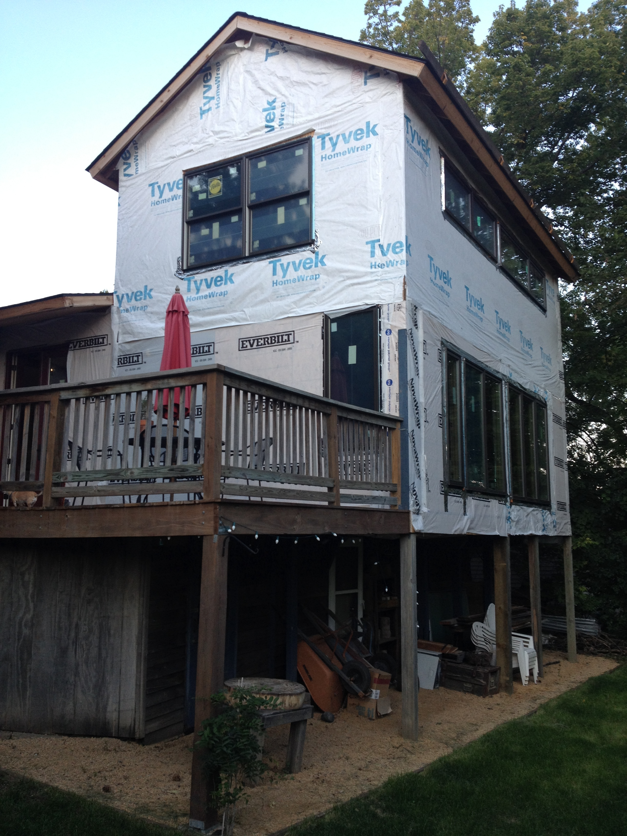 during: southeast.   2-story deck is now framed in, and the west deck, which was at an angle, is now squared off. This south wall faces the Mississippi River, which is why we wanted to go with a full wall of windows.