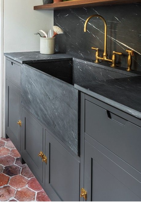 3. Sinks + Countertops + Splashes    While brass has been trendy for a year or so now, we're loving it combined with black on black on black. Can't afford a black marble sink? Doing a black granite undermount can achieve the same look as long as you use black cabinetry, countertops and backsplash.