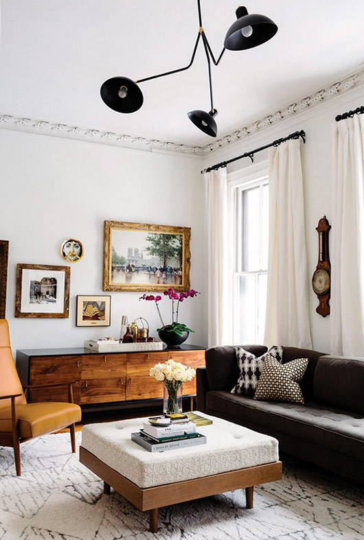 4. Furniture + Hardware   For a less permanent way to incorporate black into your space bring in some black furniture and hardware. We love how these black couches and light fixture create bold statements without overpowering the space.