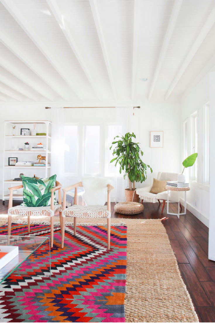 Colorful on neutral rug layers – Layering rugs trend inspiration. Check our ideas at www.olliePopDesign.com and follow us on Pinterest @olliepop_design for more interior design and home decor ideas #homedecor #rugs #interiordesignideas