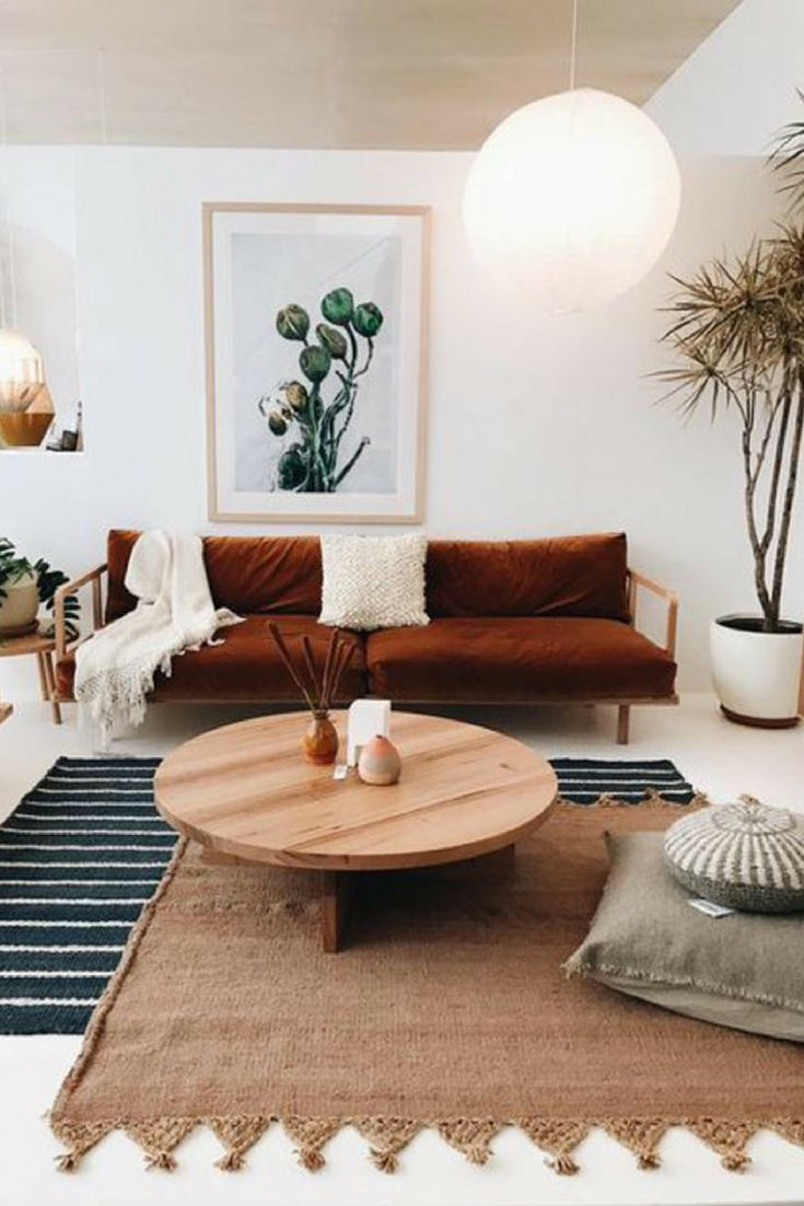 Stripped rug to add color and complement neutral living room– Layering rugs trend inspiration. Check our ideas at www.olliePopDesign.com and follow us on Pinterest @olliepop_design for more interior design and home decor ideas #homedecor #rugs #interiordesignideas
