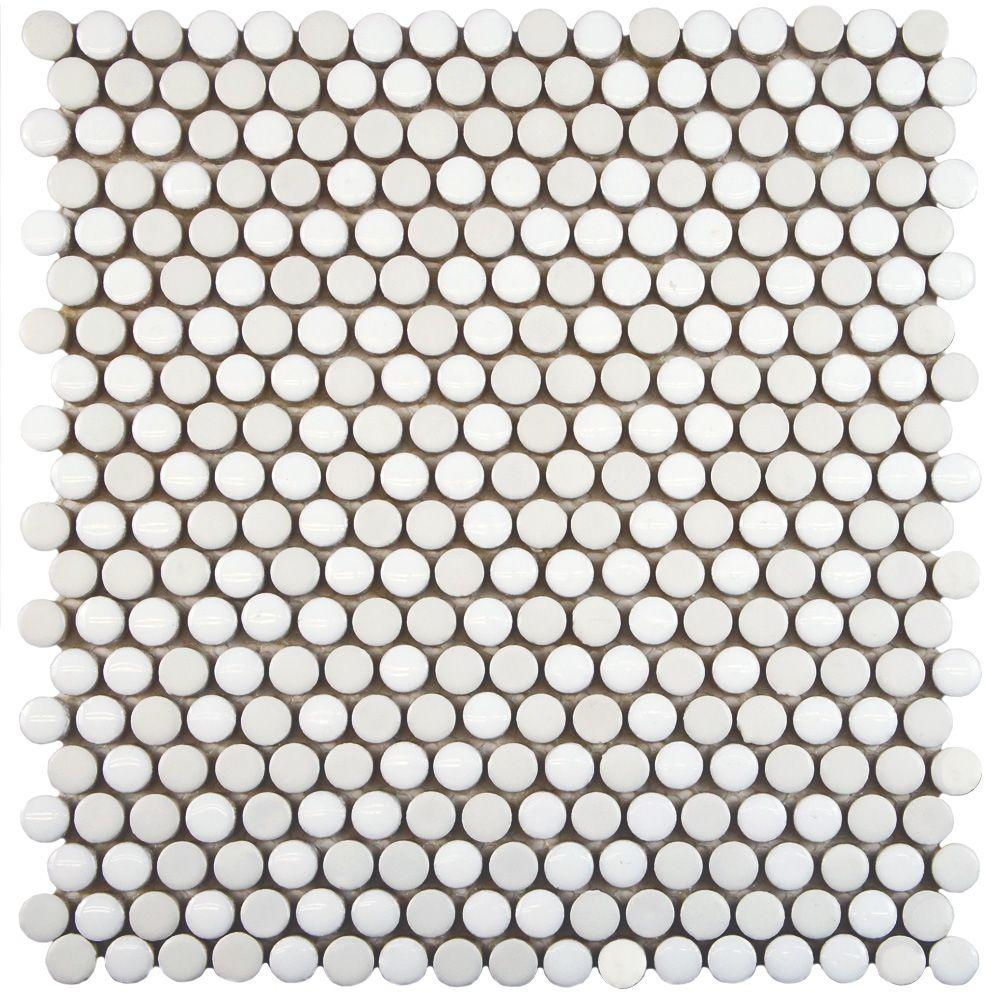 As with the grey tile, the white is a mix of glossy and matte tiles on each sheet, so while it's white it actually has a lot of dimension and movement to it. These are custom ordered through one of our vendors but you may be able to get them online at Home Depot.