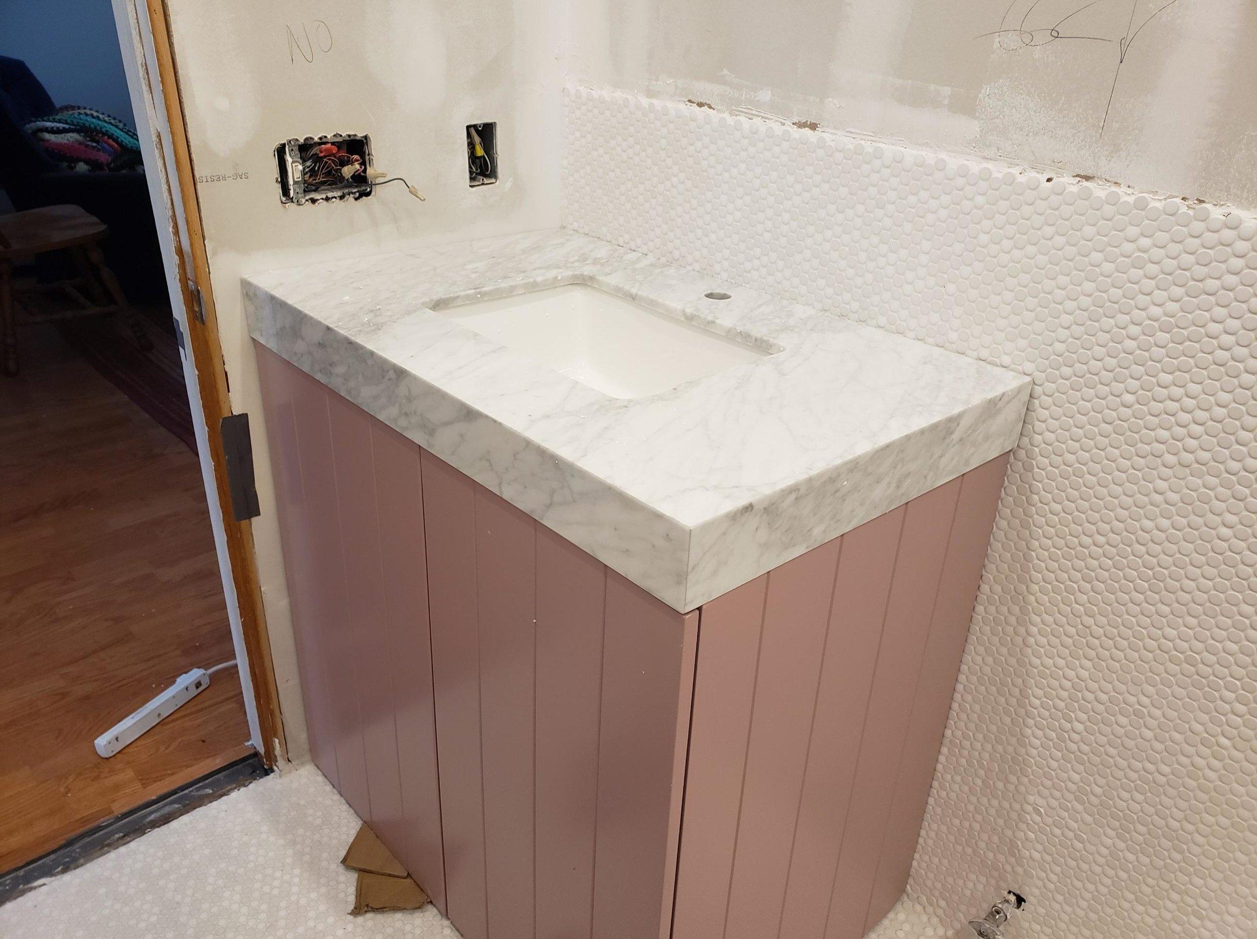 mauve pink bathroom vanity Carrara marble countertop